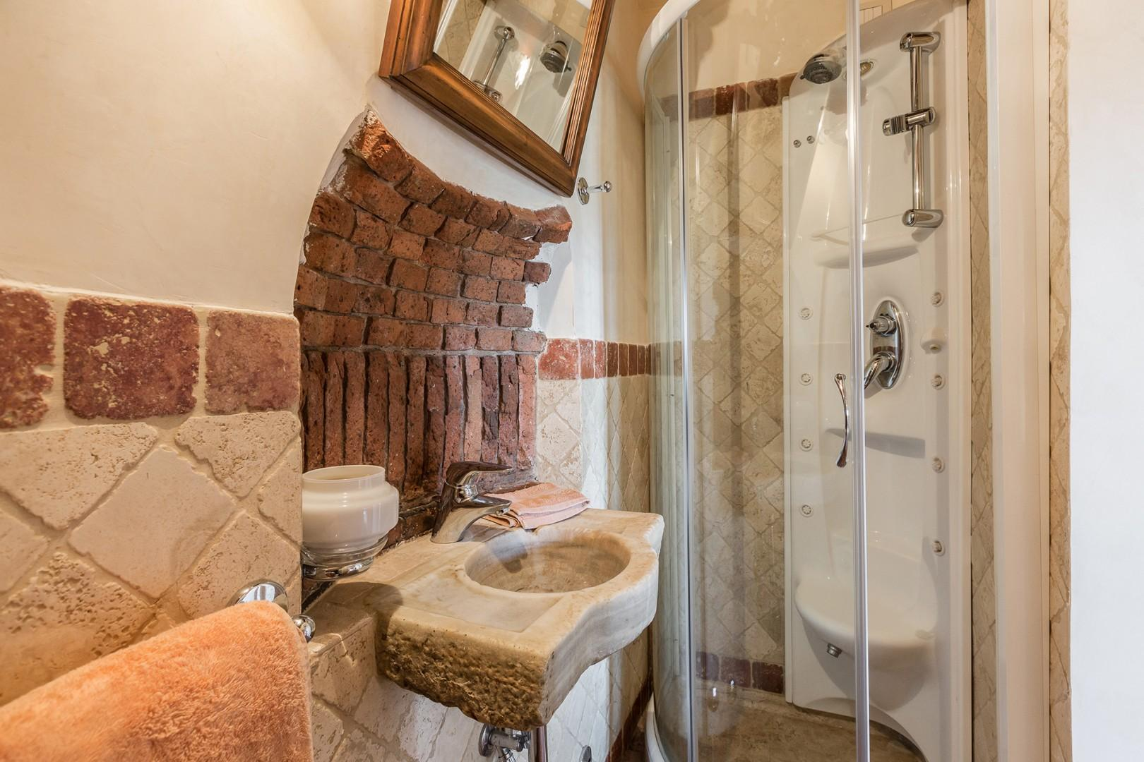 This bathroom adjoins the small dining room. Interesting brickwork above sink.