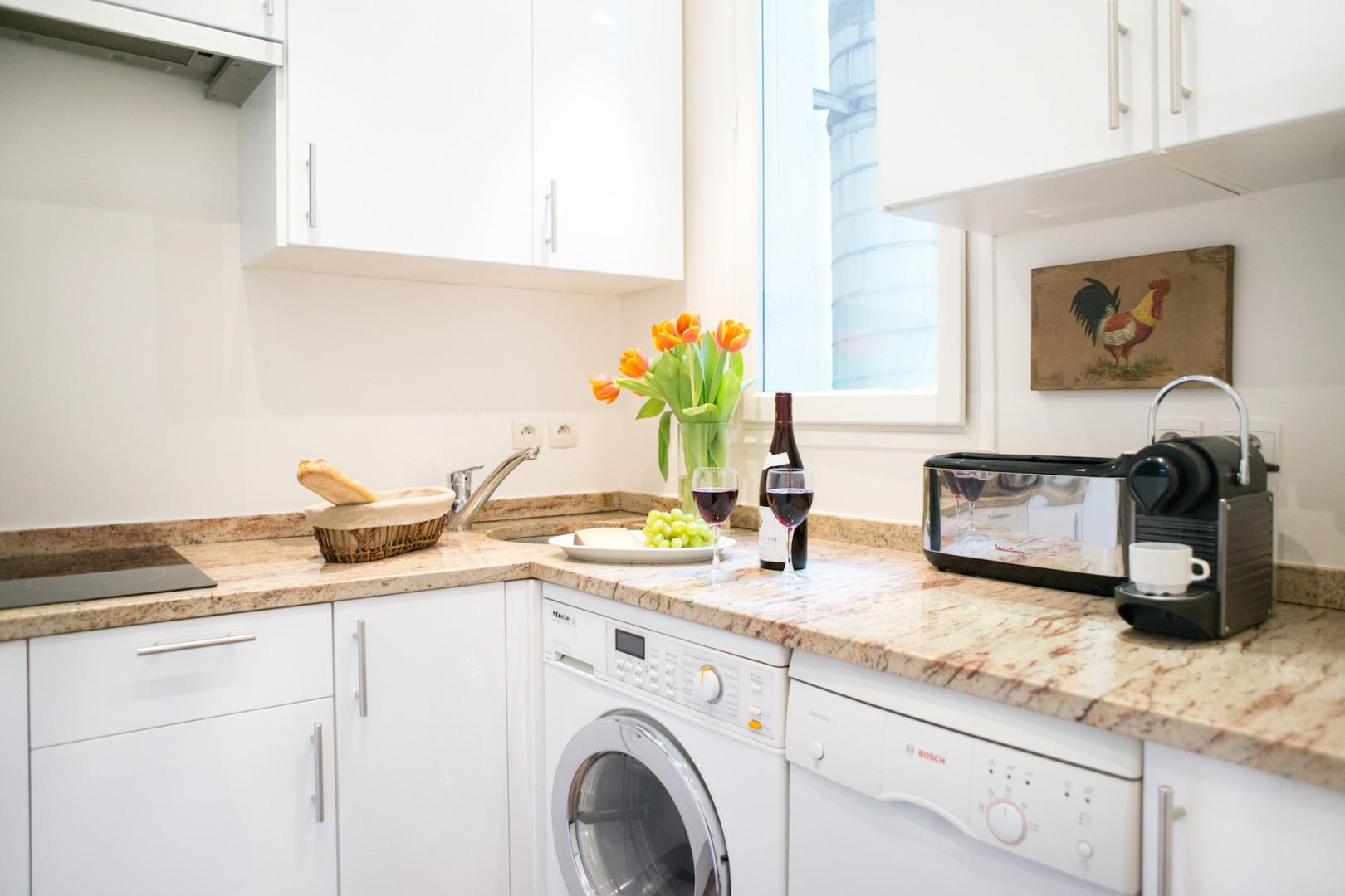 The fully equipped kitchen with modern appliances has everything you need.