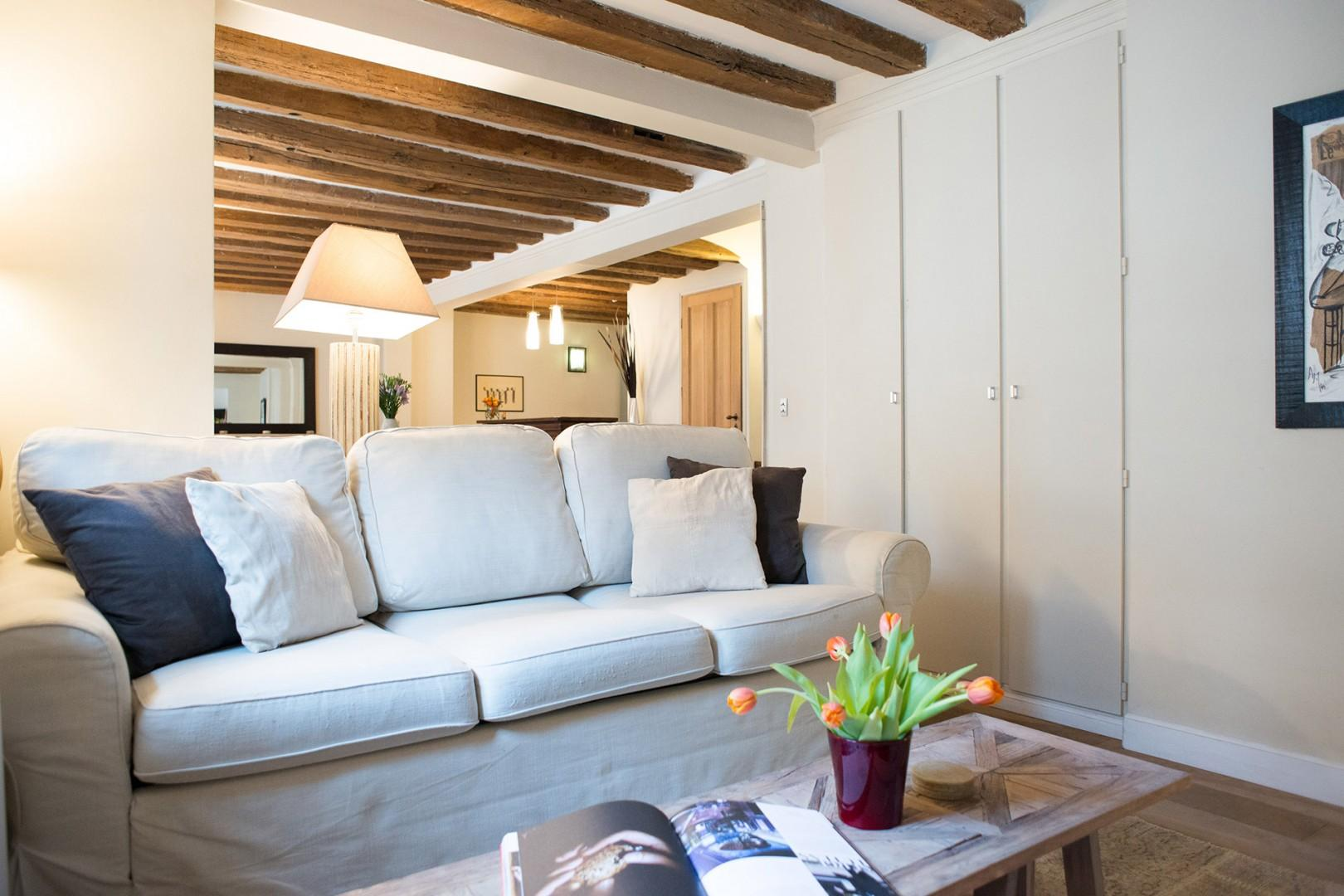 Warm and inviting, the apartment exudes a French countryside vibe.