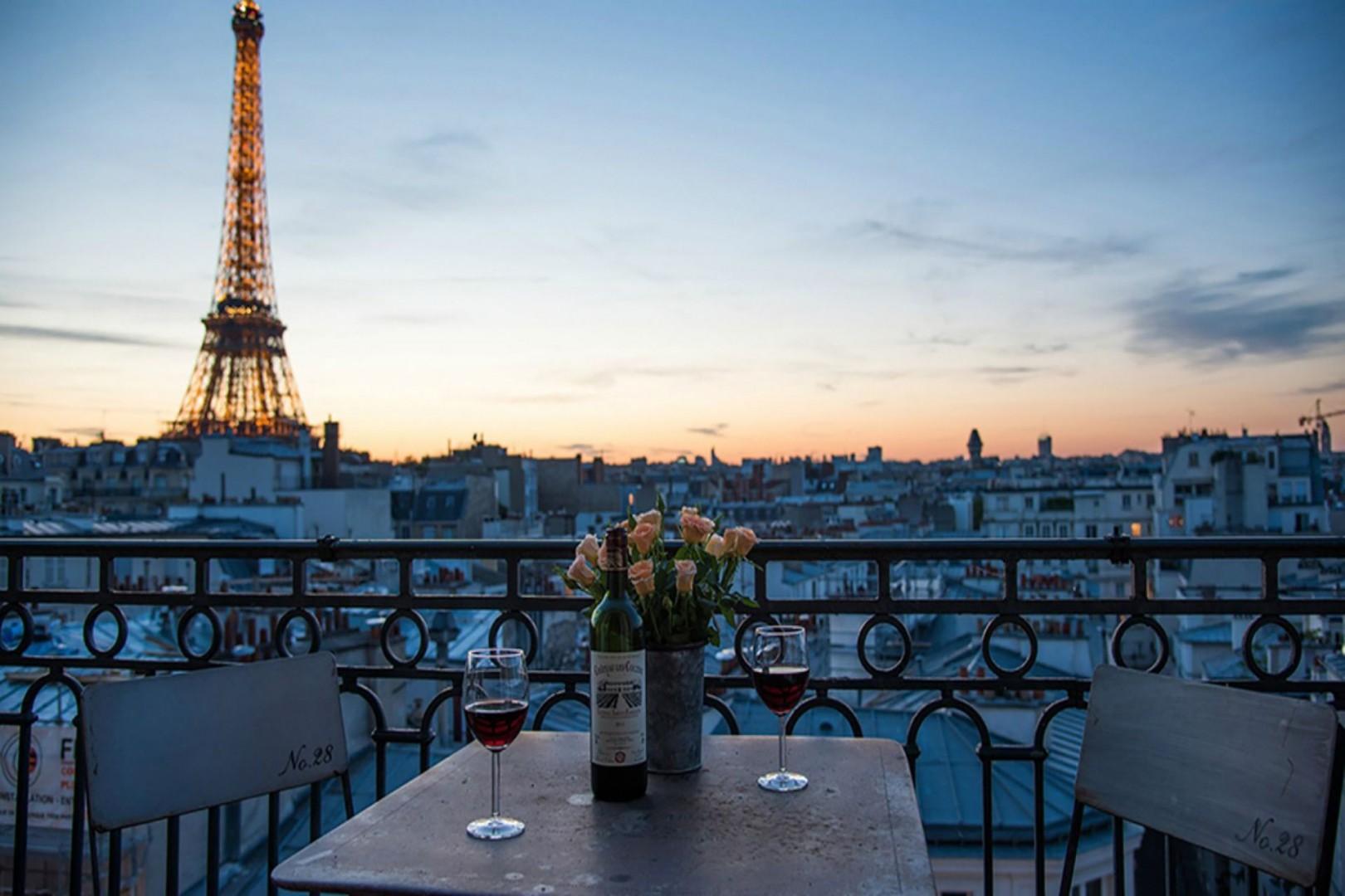 Enjoy unforgettable Eiffel Tower views while dining al fresco.