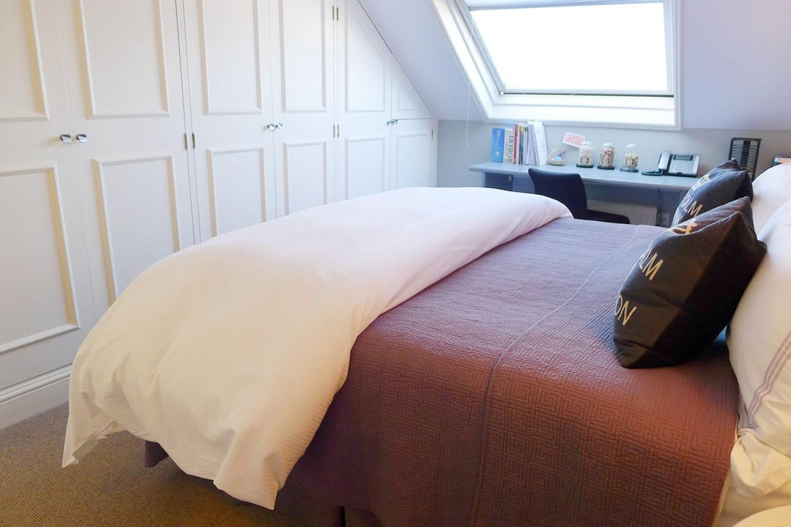 Large built in closets and a comfortable bed that can be unzipped to form two beds