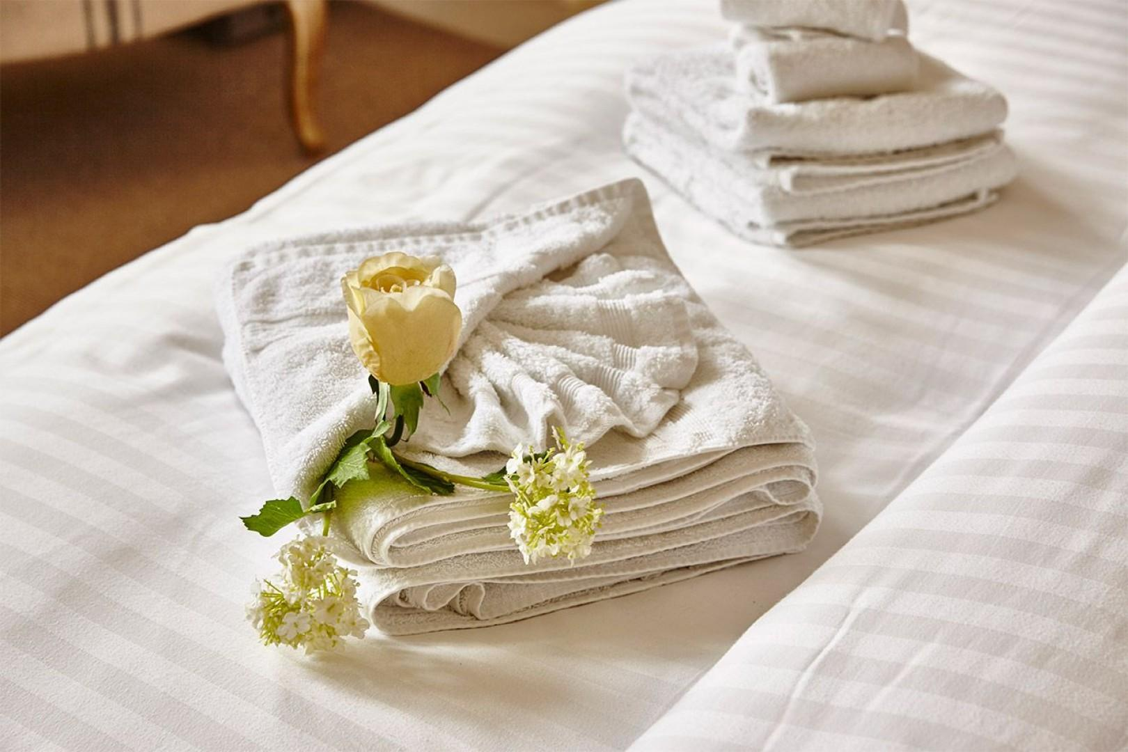 Tuck a rose into your towels for a romantic touch!