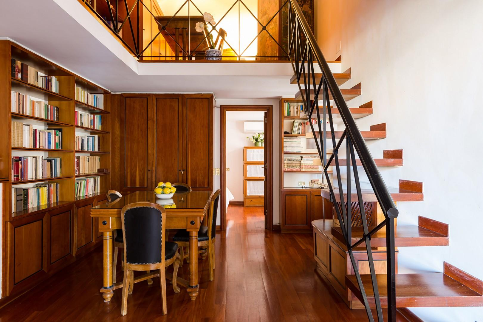 Stairs from the dining room lead to the mezzanine level.