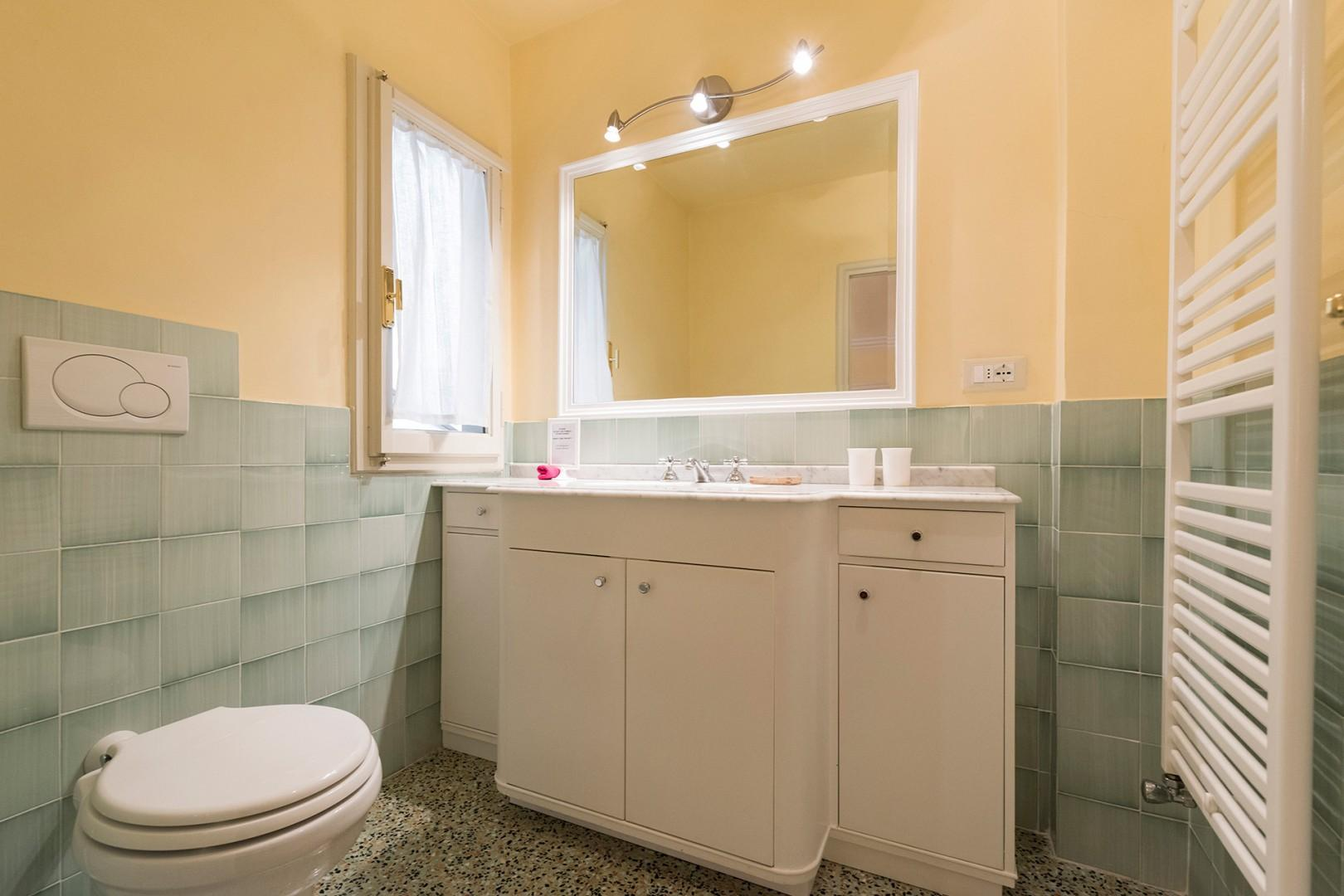 This bathroom has a shower and is en suite to bedroom 1