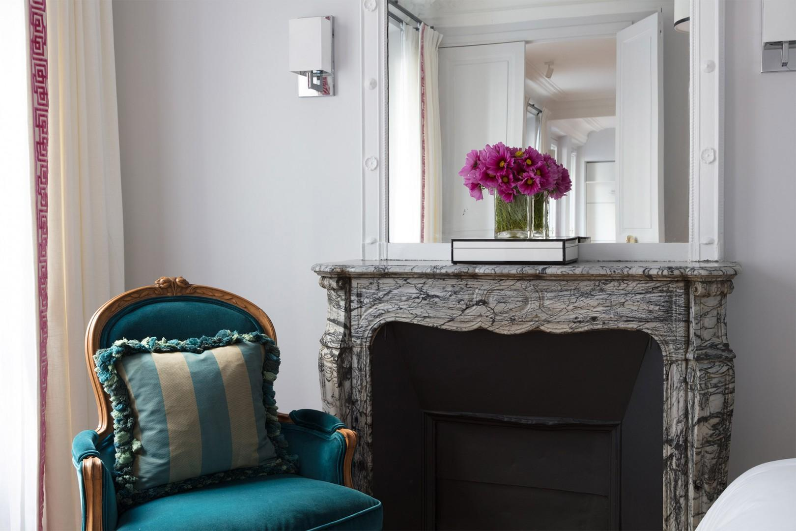 The marble fireplace in bedroom 1 adds lots of charm.