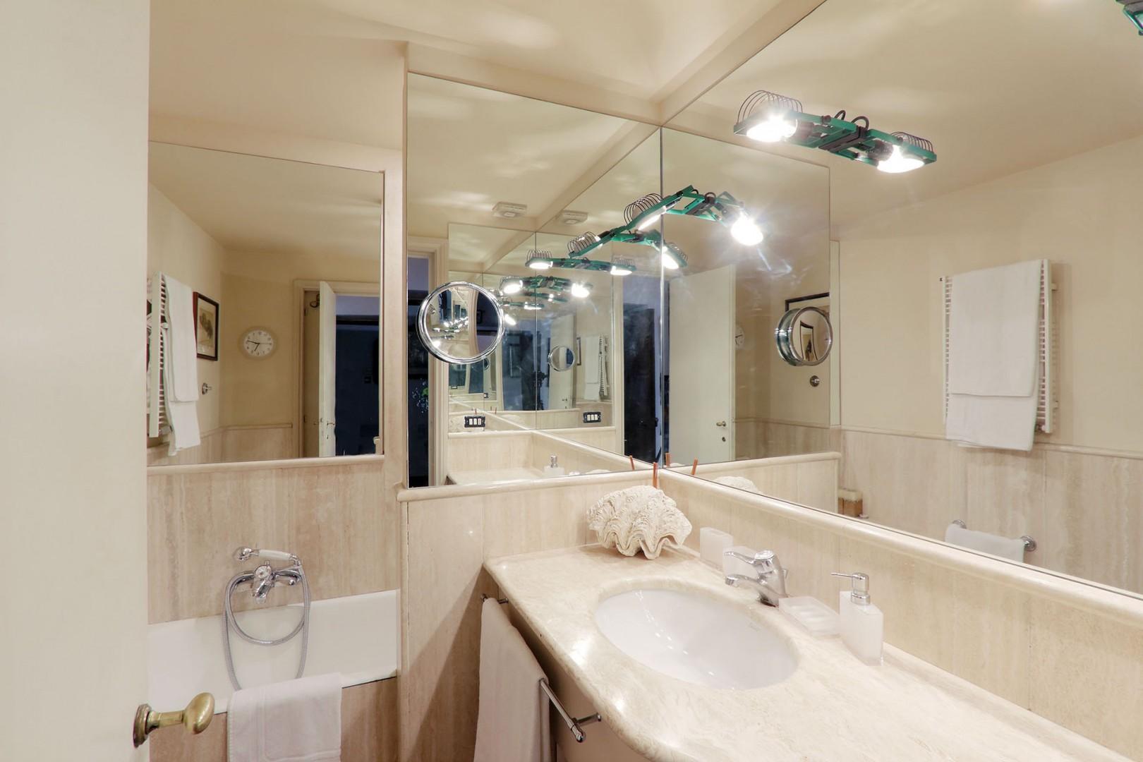 Marble bathroom en suite with bedroom 1.