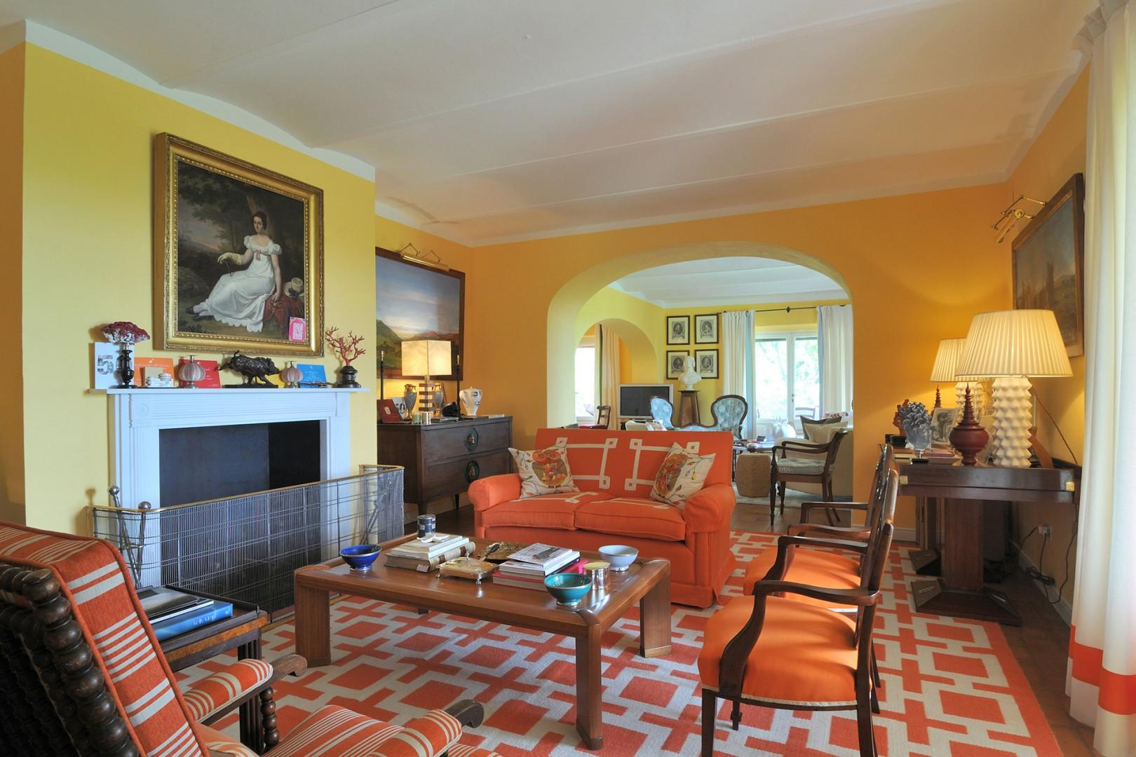 A double living room with working fireplace provides a wonderful atmosphere for enjoyment.