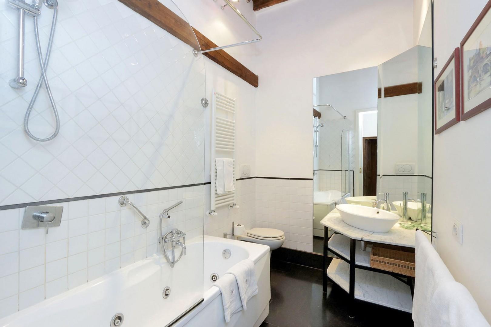 En suite bathroom for bedroom 1 is clean and modern.