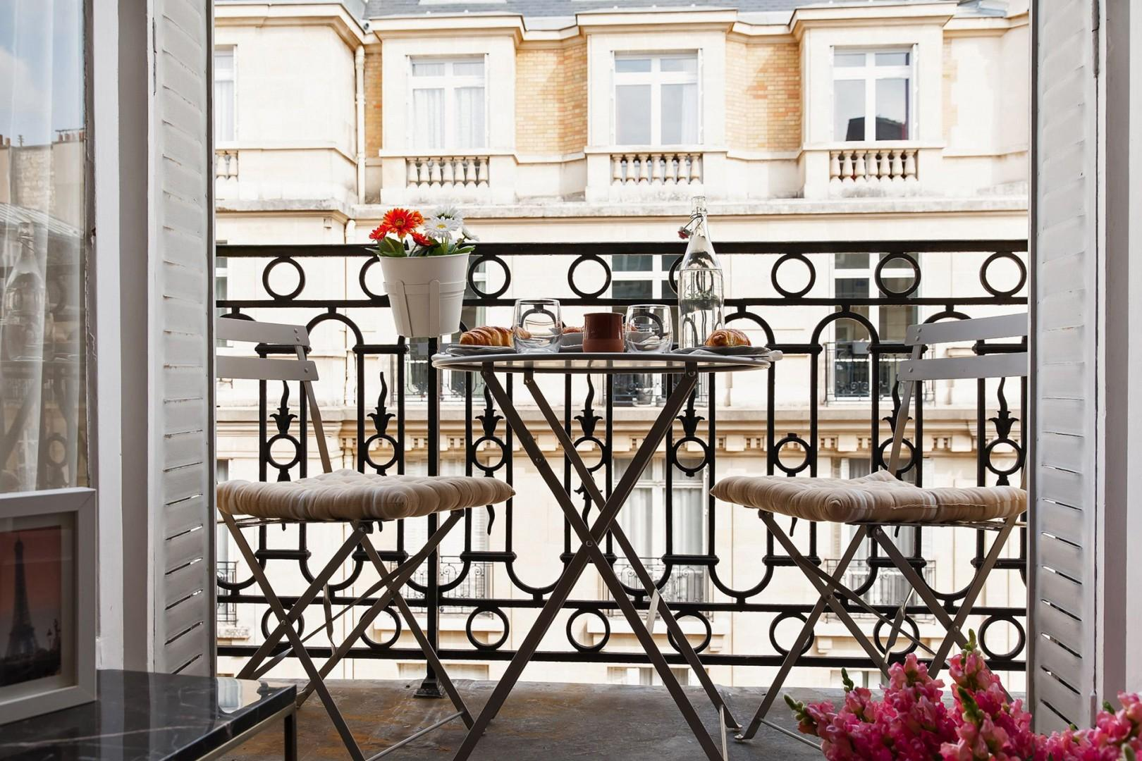 Charming balcony with a table perfect for two!