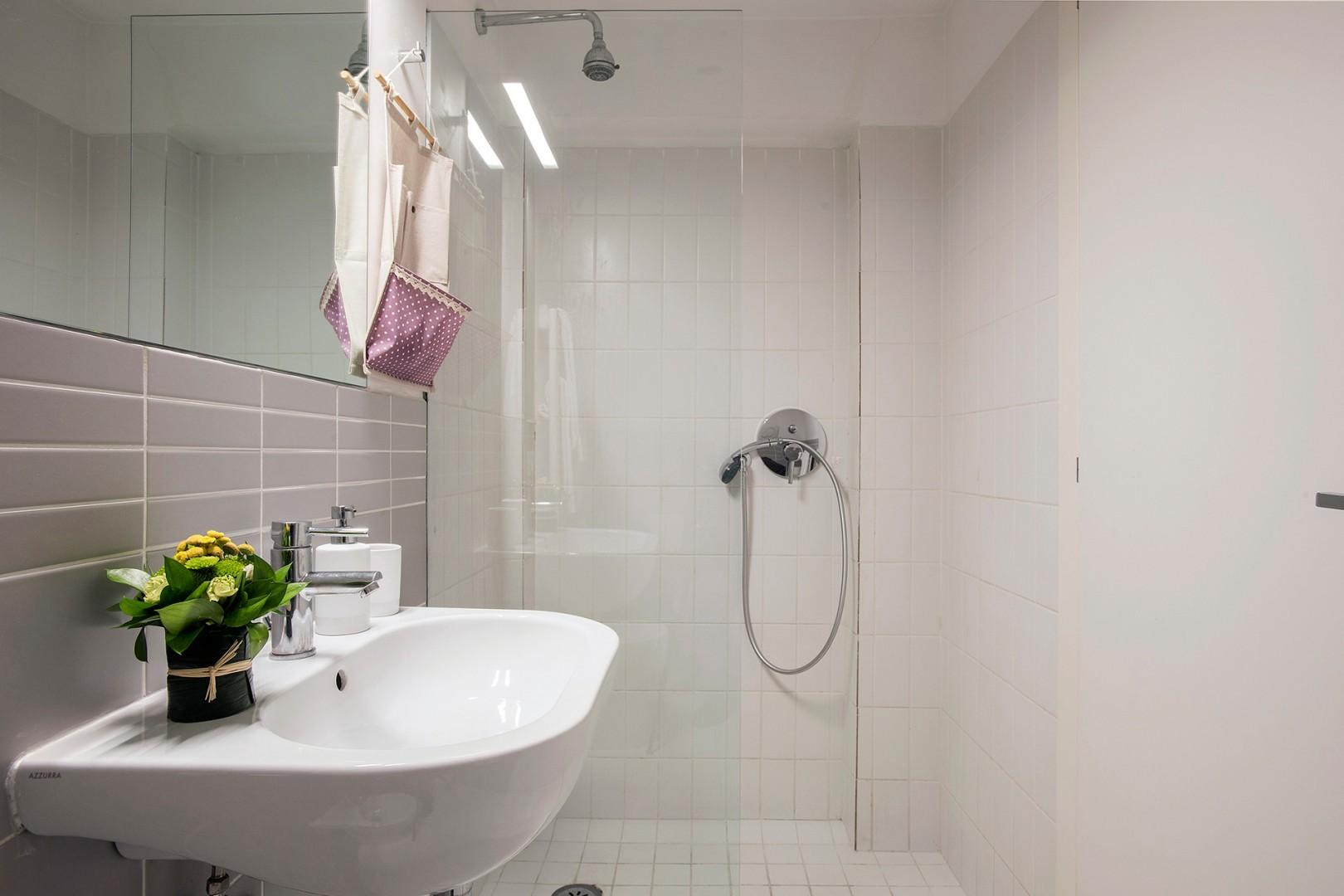 Large shower in bathroom 1.