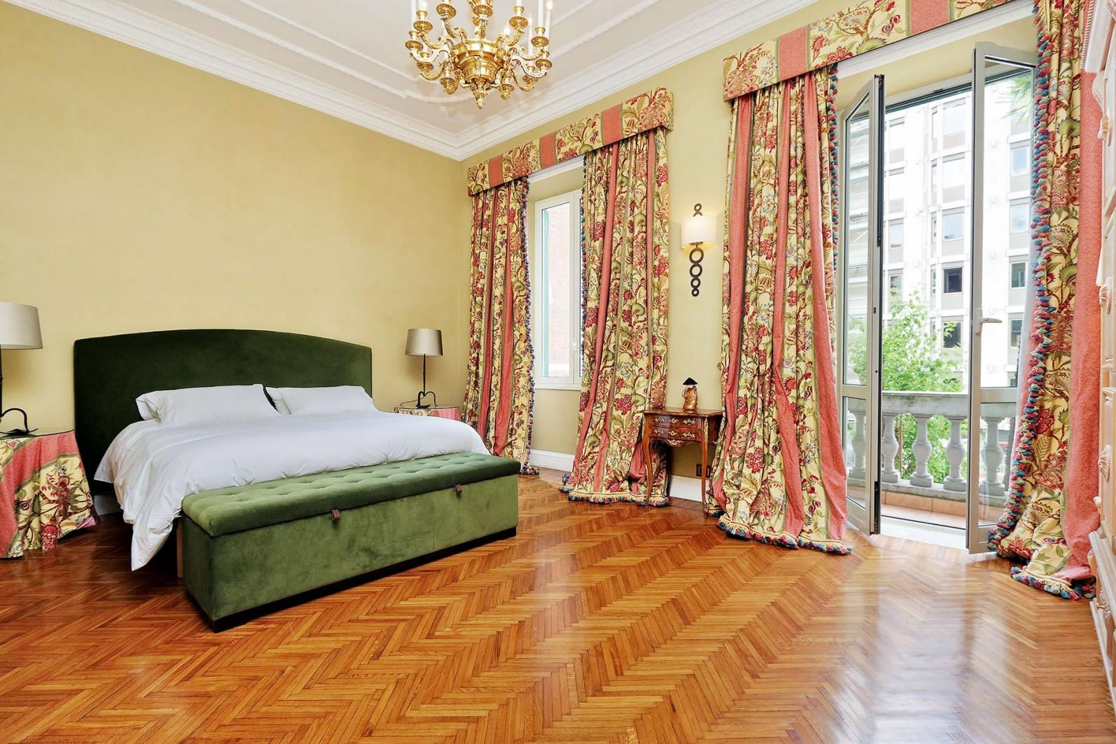 Large, comfortable bedroom 1 with french door leading out to a narrow balcony.