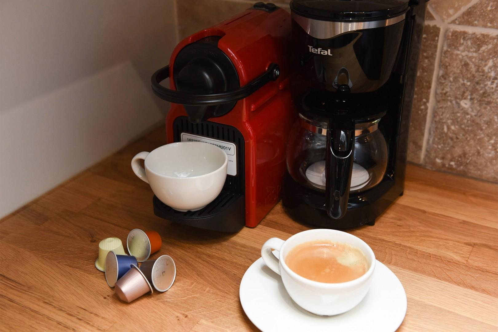 The kitchen is stocked with a Nespresso maker and capsules.