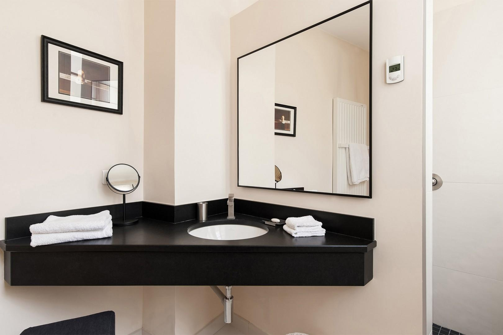 Enjoy the high-end finishes in the bathroom.