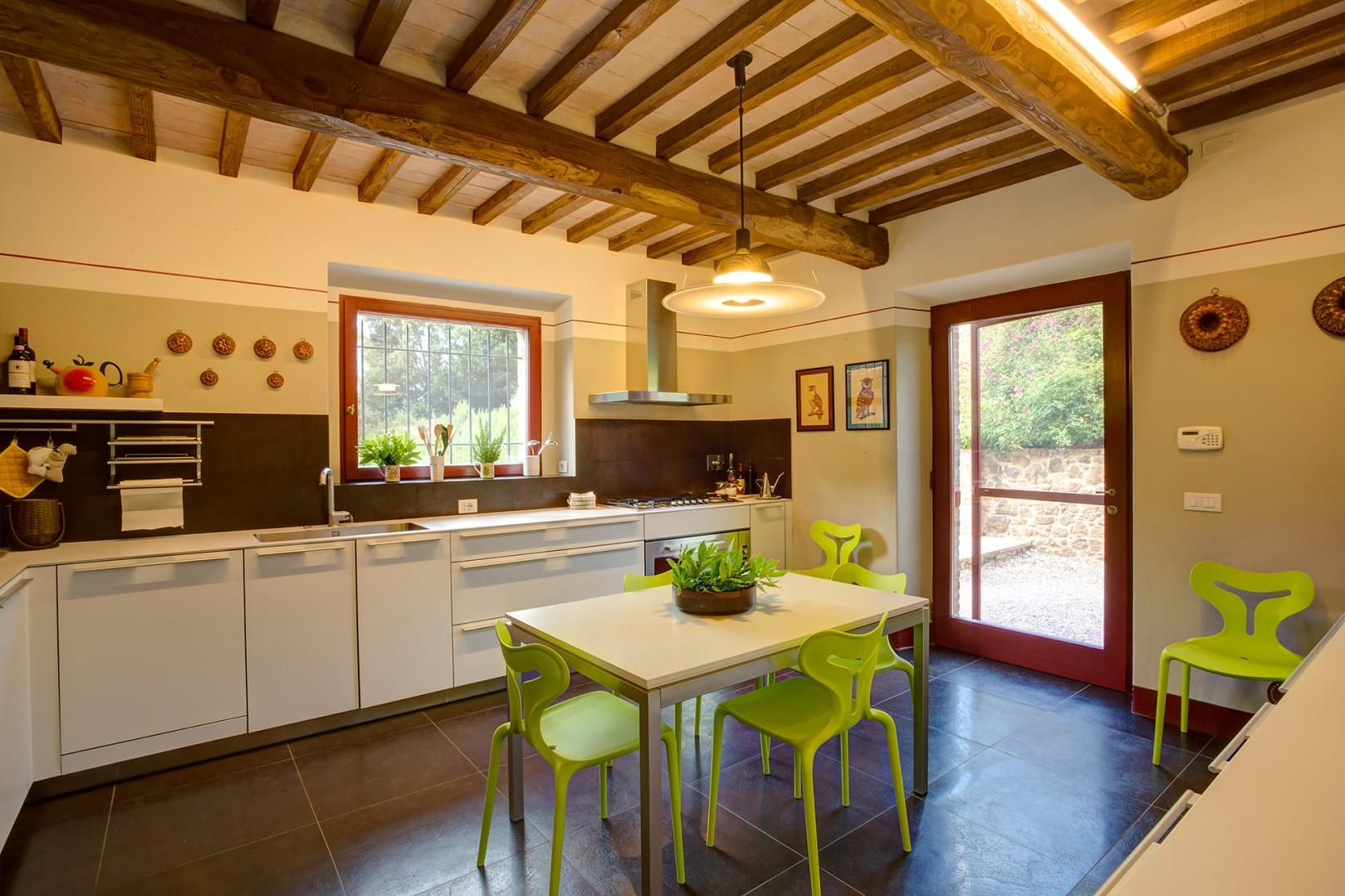 Cheery kitchen is large by Italian standards and fully appointed.