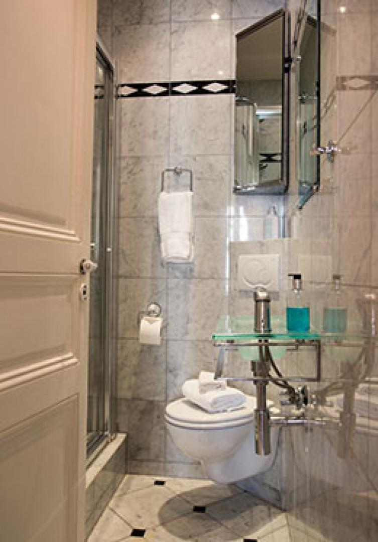 Bathroom 2 with glass-enclosed shower