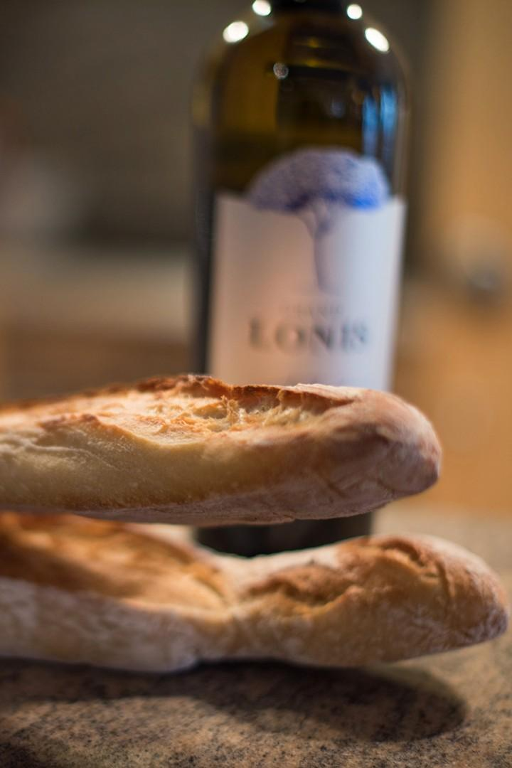 Have fresh baguettes and wine at home.