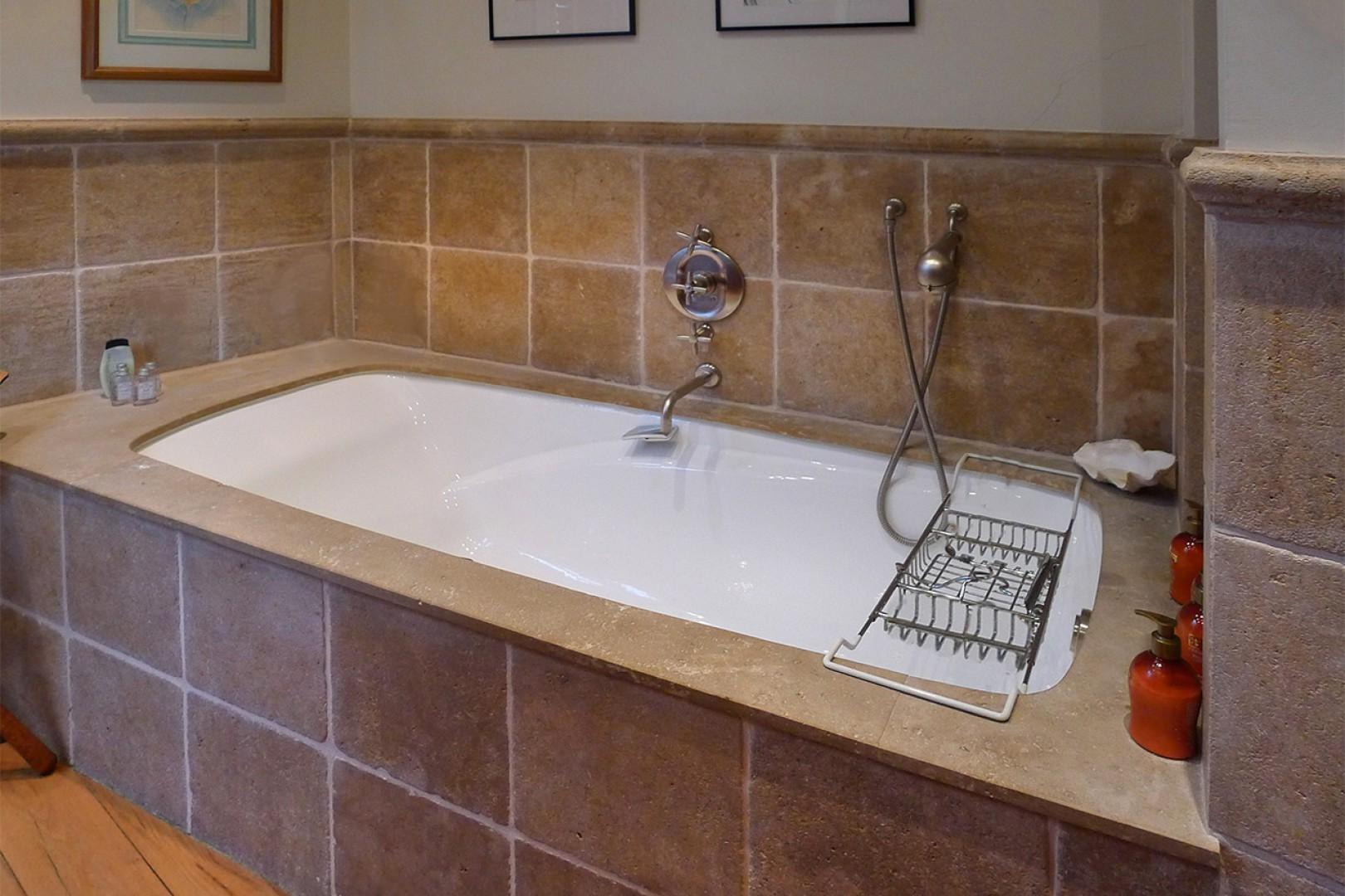 Enjoy a relaxing soak in this luxurious bathtub.