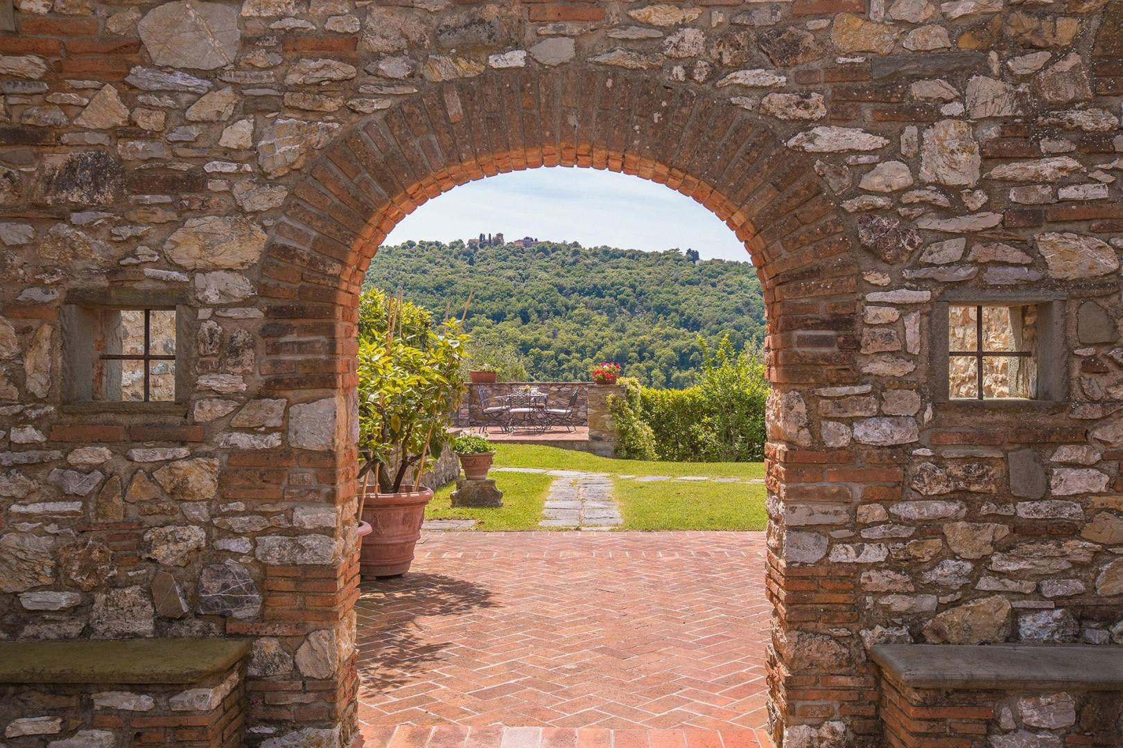 An archway frames another outdoor space where you can sit and enjoy the views.