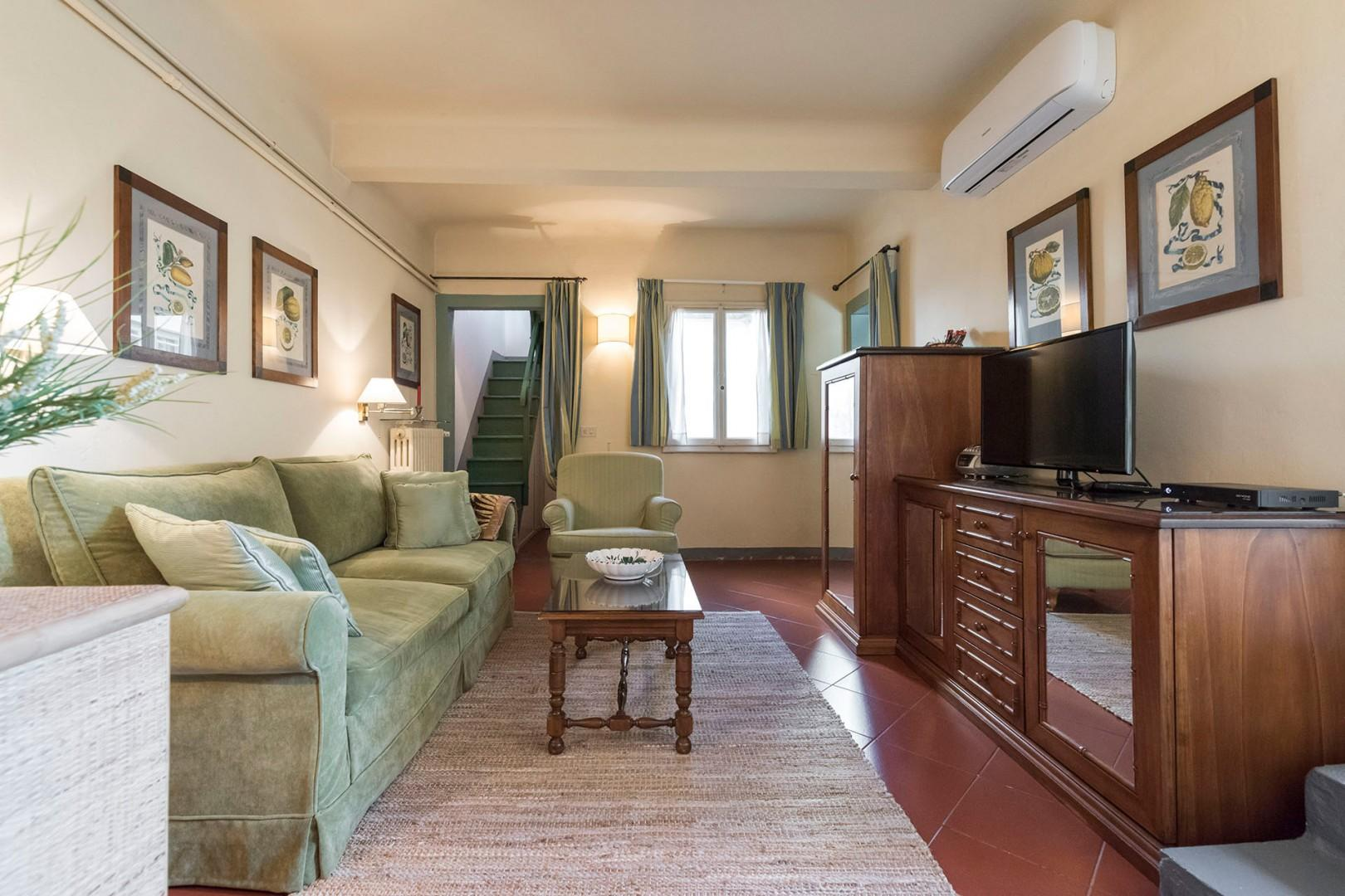 The cozy living room is very comfortable, a little retreat for relaxing between excursions.