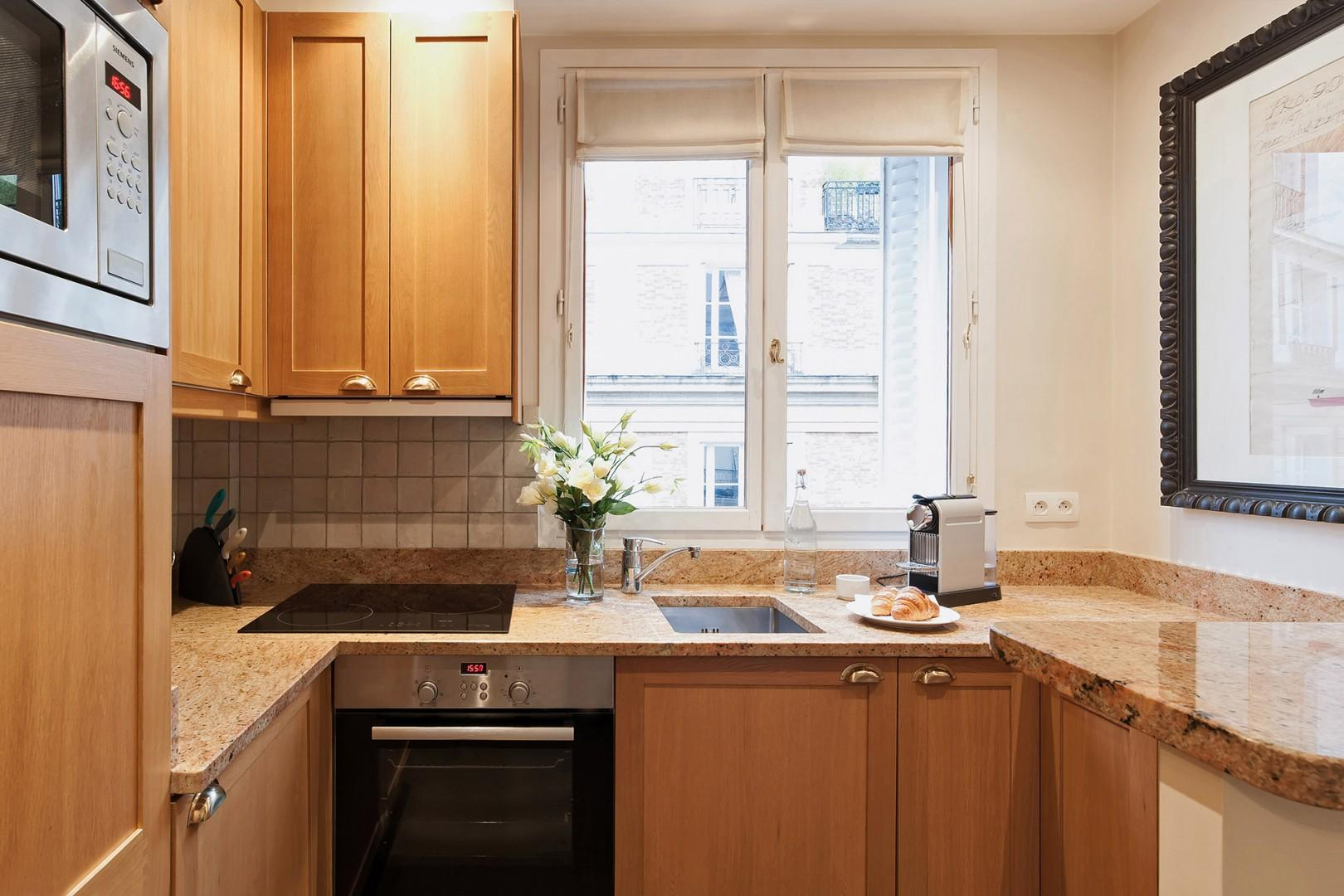 Enjoy cooking in this modern designer kitchen with cherrywood and granite.
