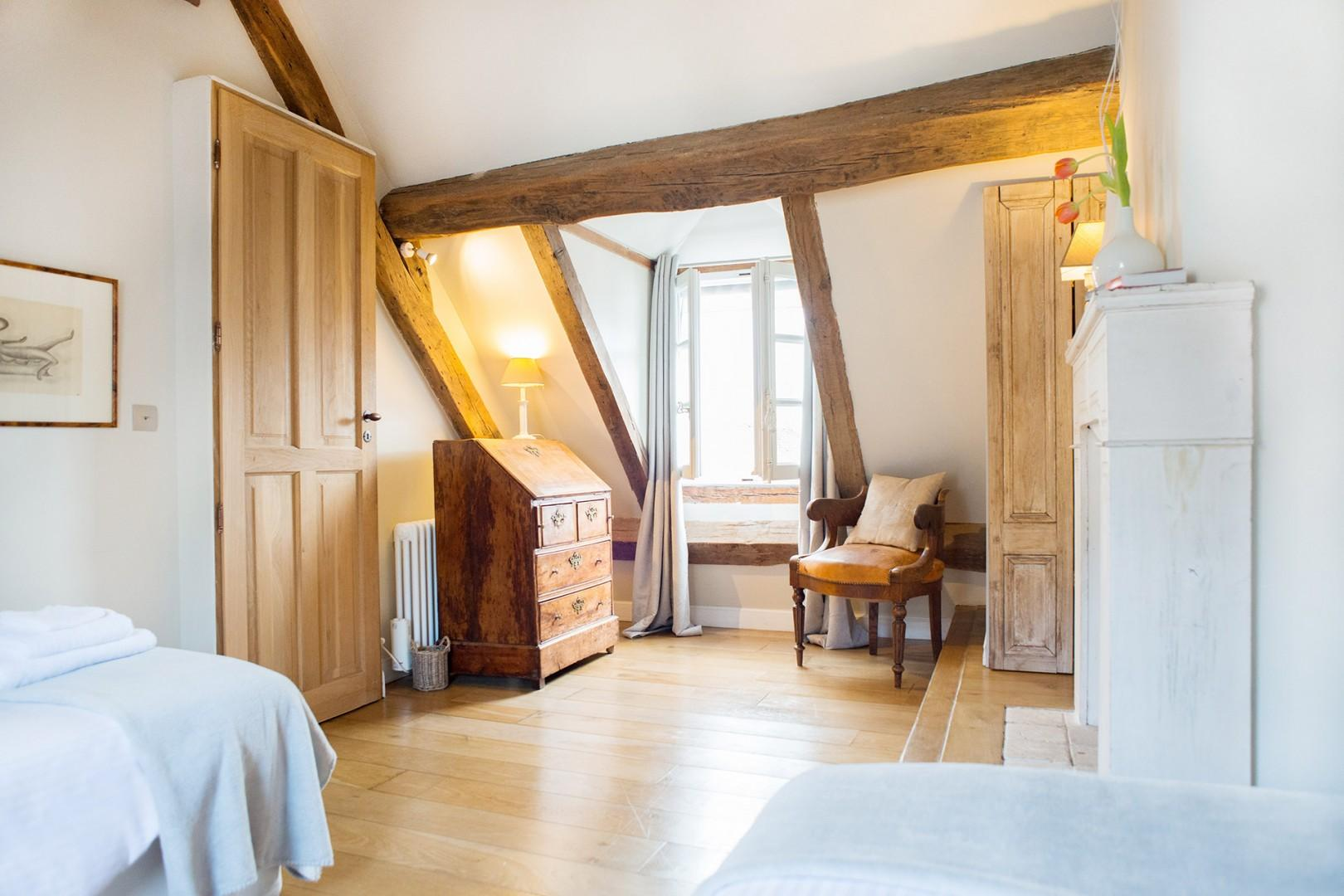 The oak beams and slanting ceiling continue in bedroom 2.