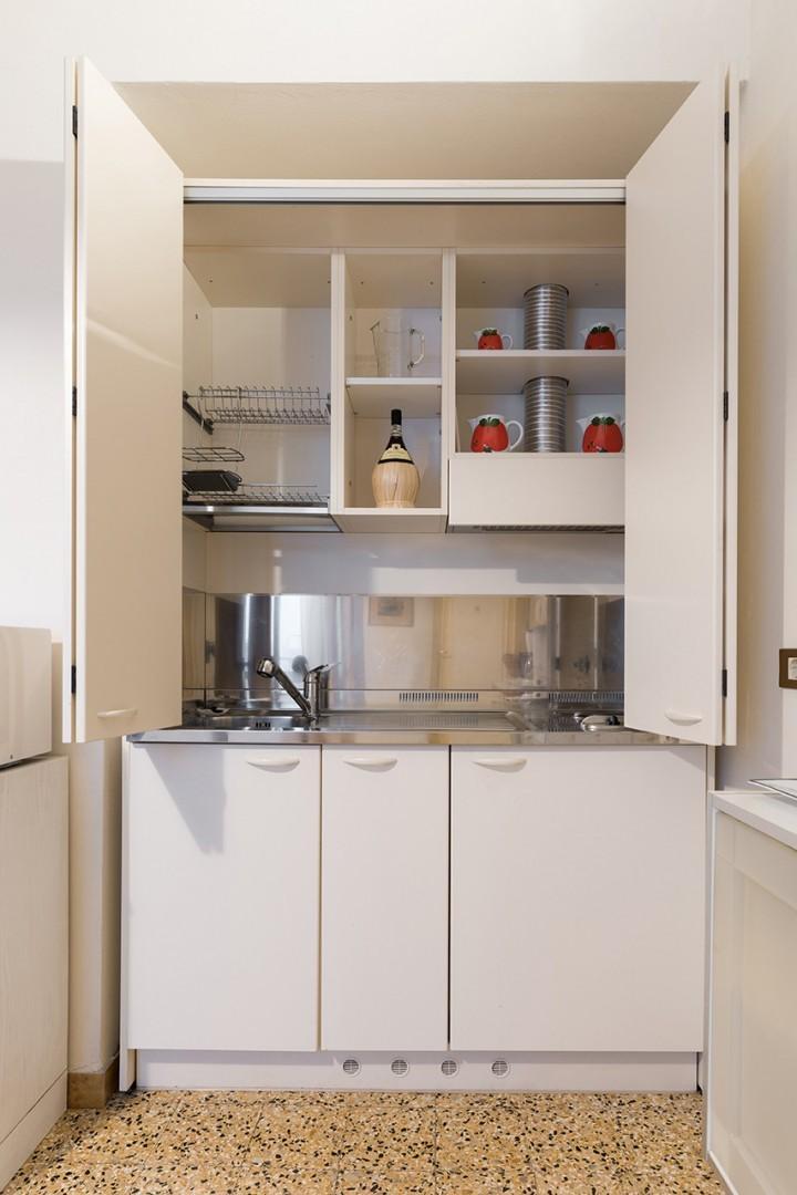 Efficiency kitchenette best for light meal preparation.