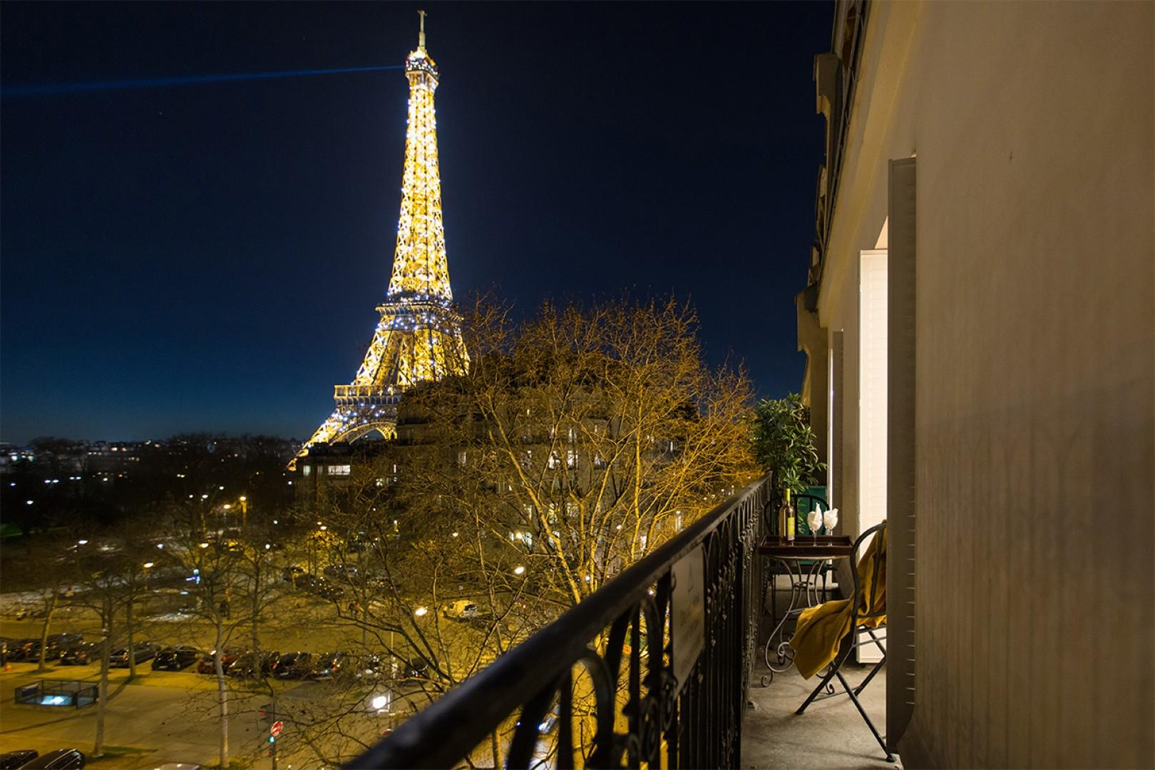 Watch the Eiffel Tower sparkle at night from your balcony!