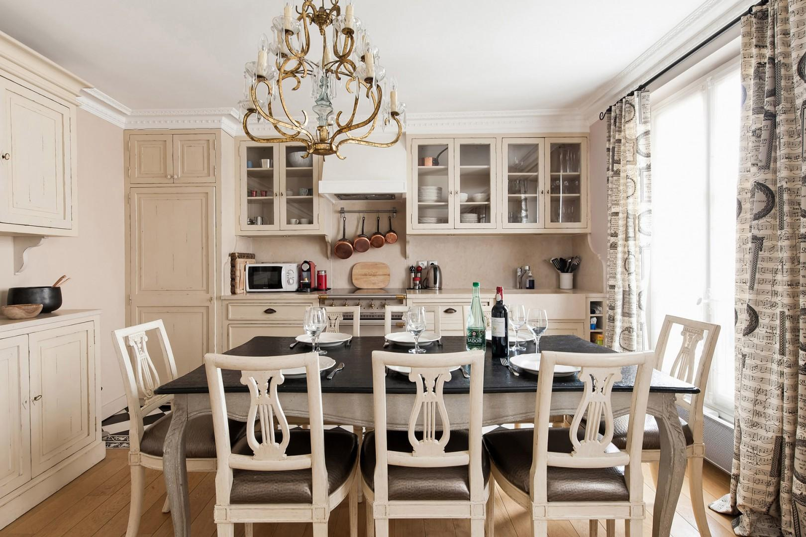 Enjoy beautiful dinners in your Parisian home away from home.