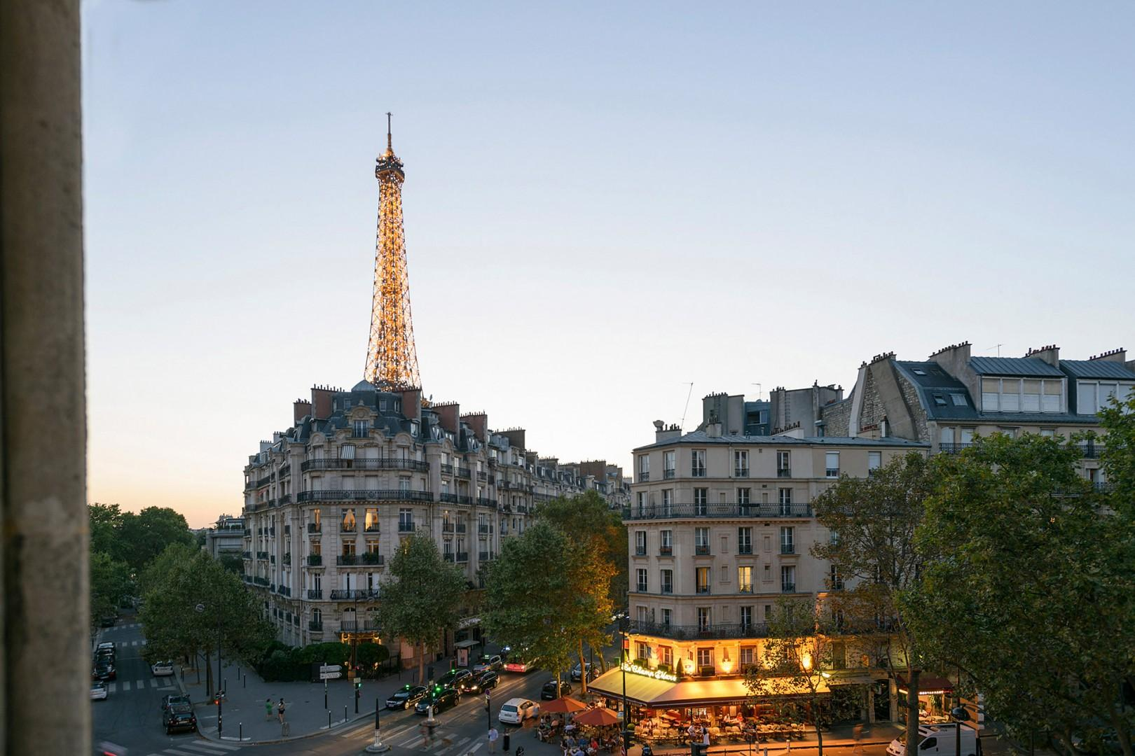 Watch the sunset and the Eiffel Tower light up at night!