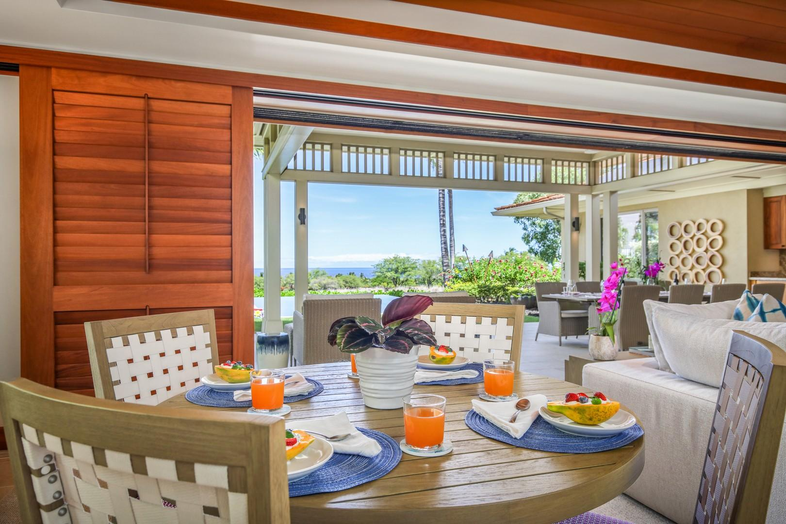 Bright and cheerful breakfast table with ocean views.
