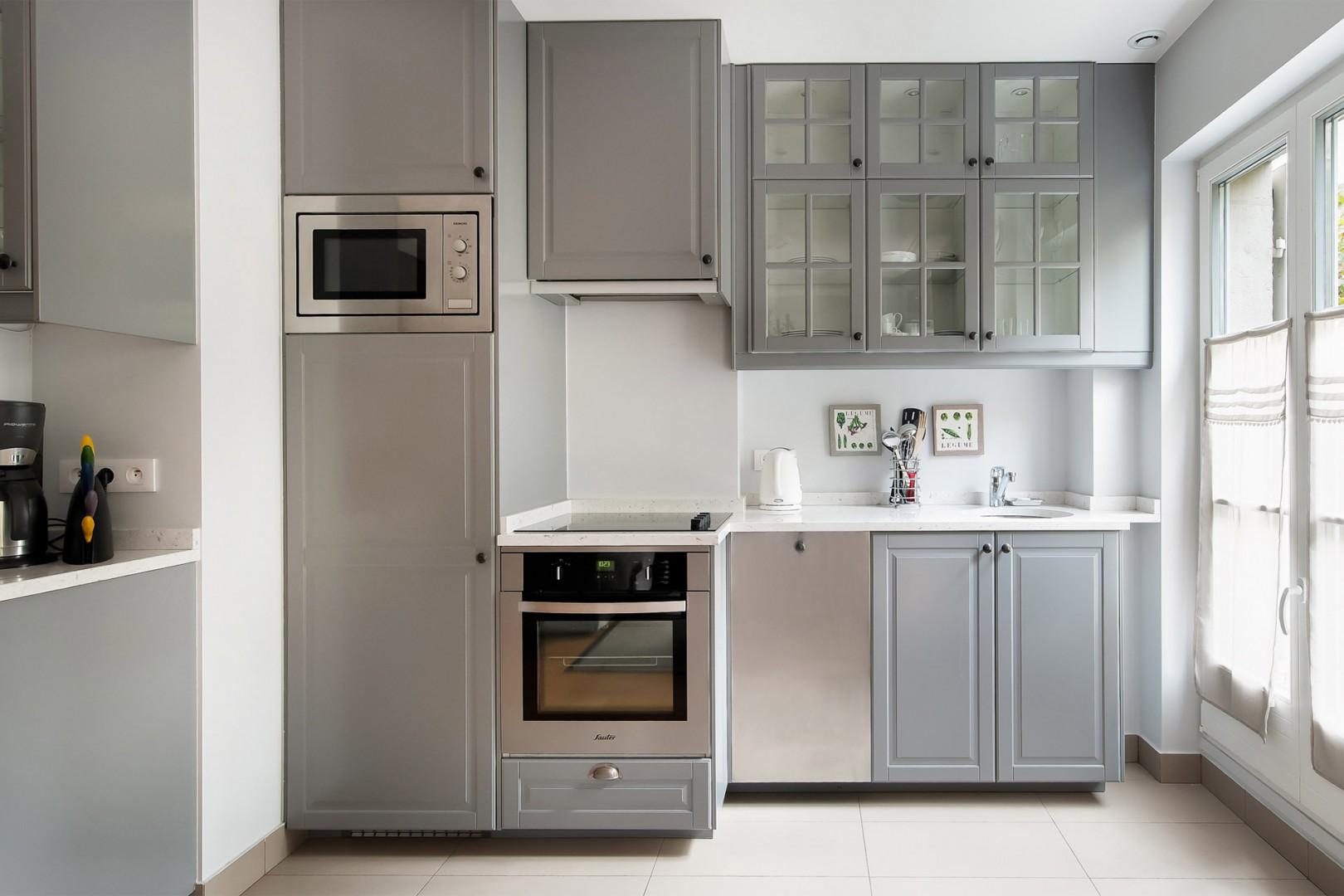 The sleek and modern kitchen has everything you need to prepare meals at home.