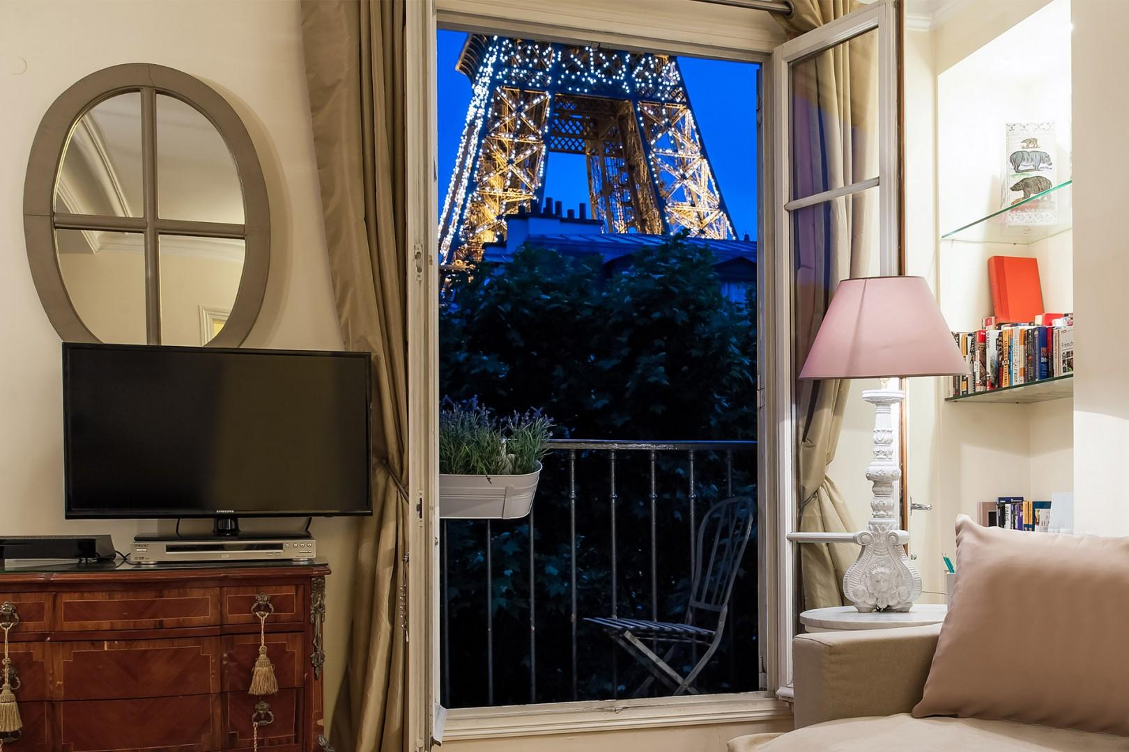 Before going to bed, watch the Eiffel Tower sparkle just outside your window.