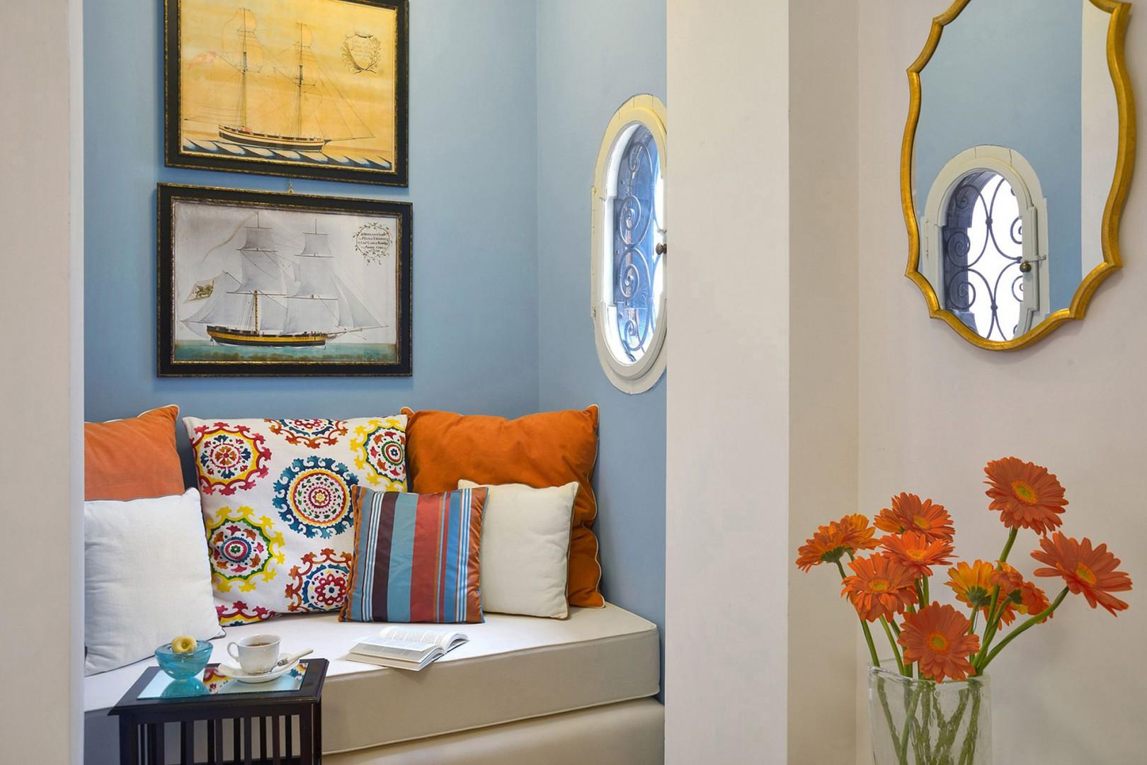 Little sofa with a porthole window for some quiet time in bedroom 2.