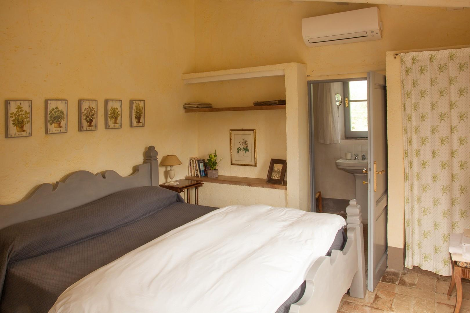 Bedroom 2 is independent with en suite bathroom. It is accessed from outside the house.
