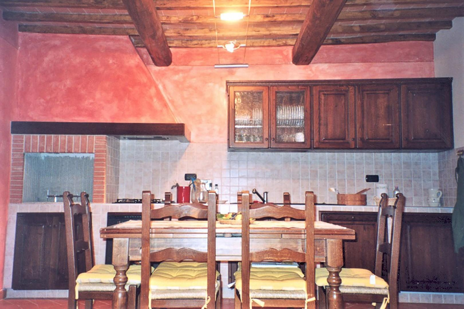 Eat-in kitchen with dining table that seats 8.