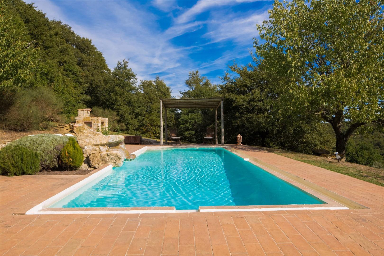 Soak up the Tuscan sun around the large swimming pool.
