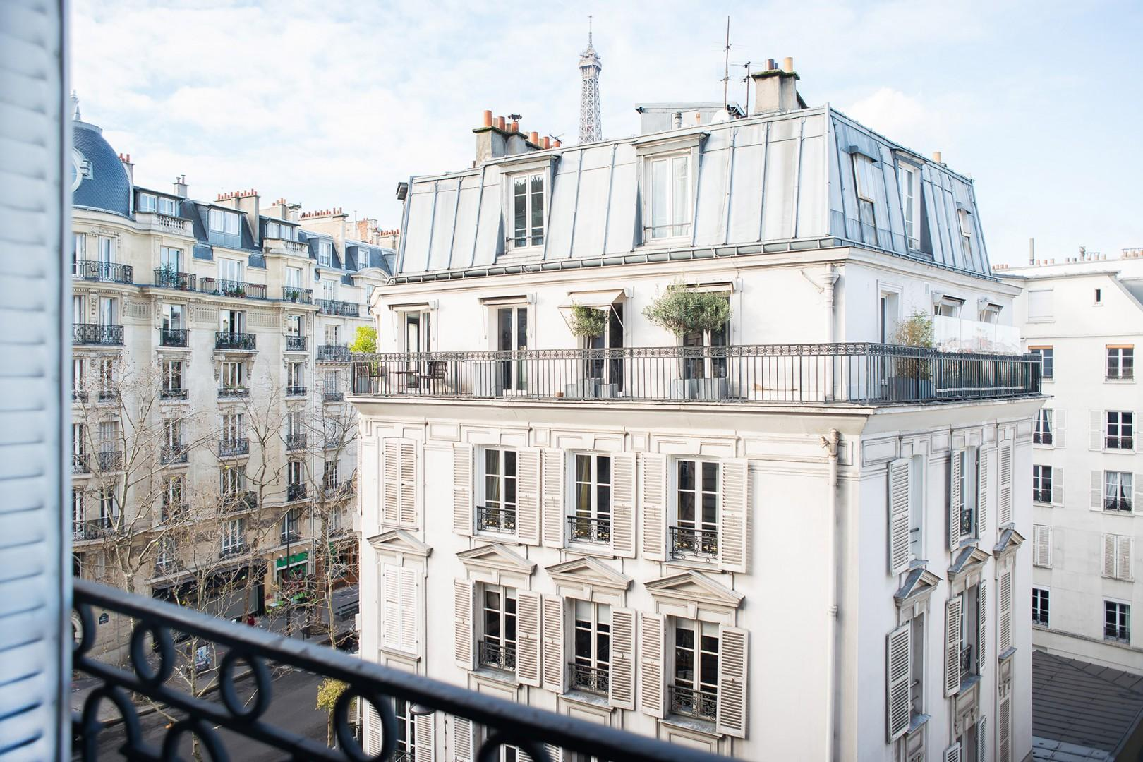 You'll have a gorgeous view of Parisian buildings and the Eiffel Tower.