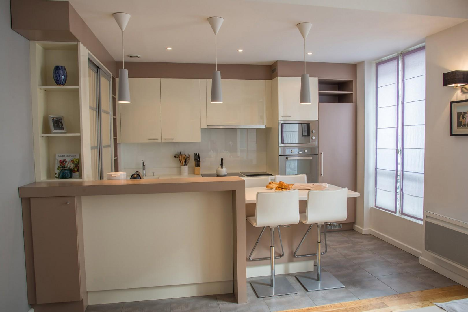 The streamlined kitchen gives the apartment a modern touch.