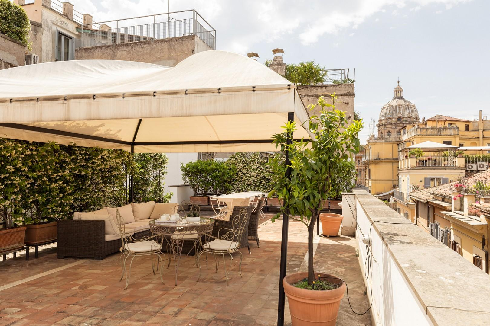 The huge terrace offers privacy as well as classic views of the Roman skyline.
