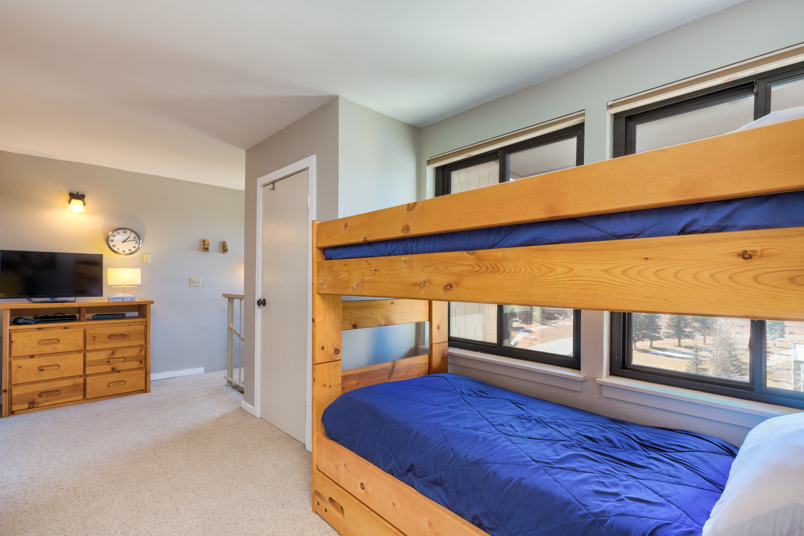 The second bedroom is in the upstairs loft and features a bunk bed with a twin trundle and a flat screen TV.