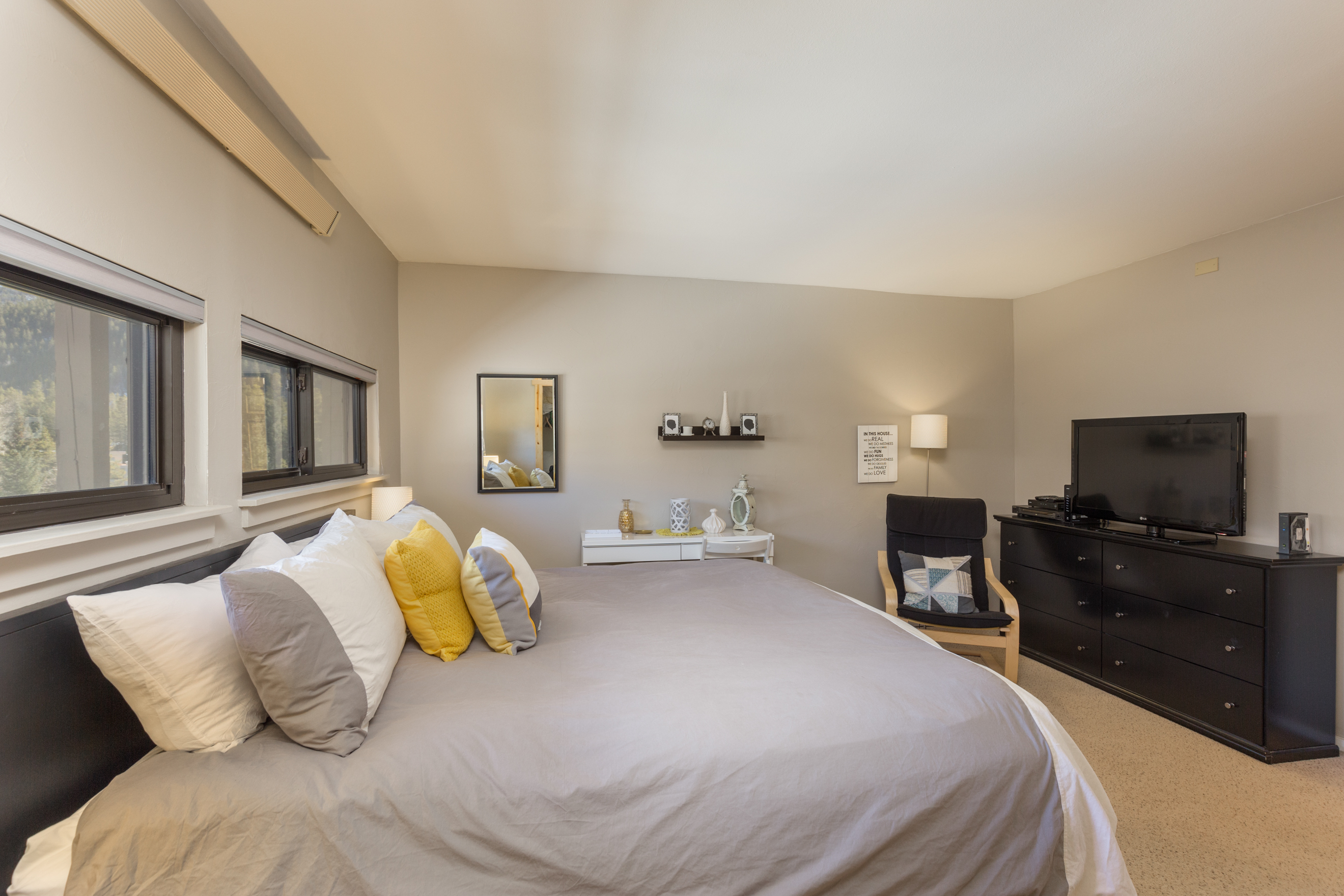 The first bedroom features a king-sized bed with Ivory White Bedding and a flat screen TV. (new photo coming soon)