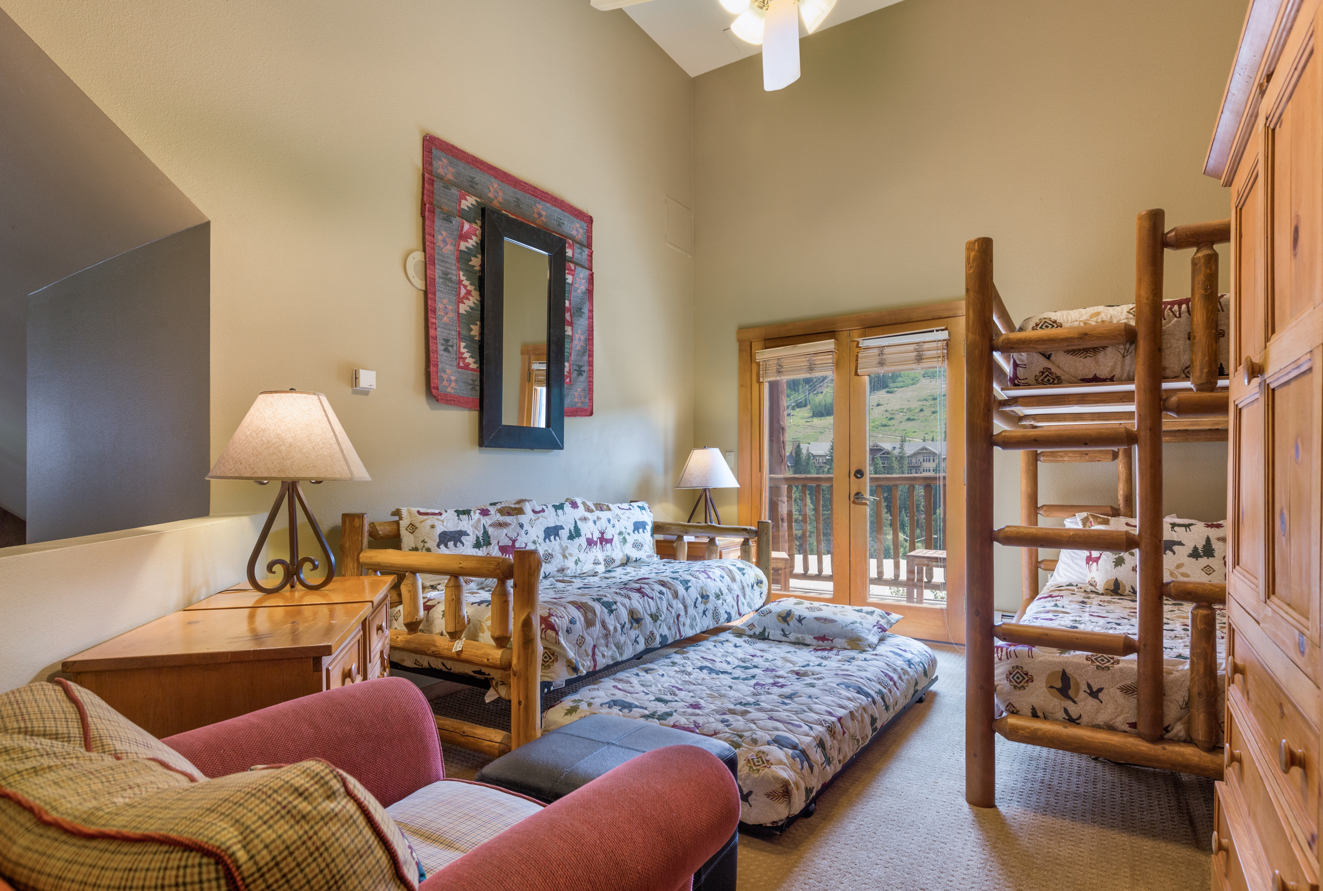 The second guest bedroom is the upstairs loft and features a bunk bed, a daybed with a twin trundle and a flat screen TV. It has its own private balcony with beautiful ski slope views.