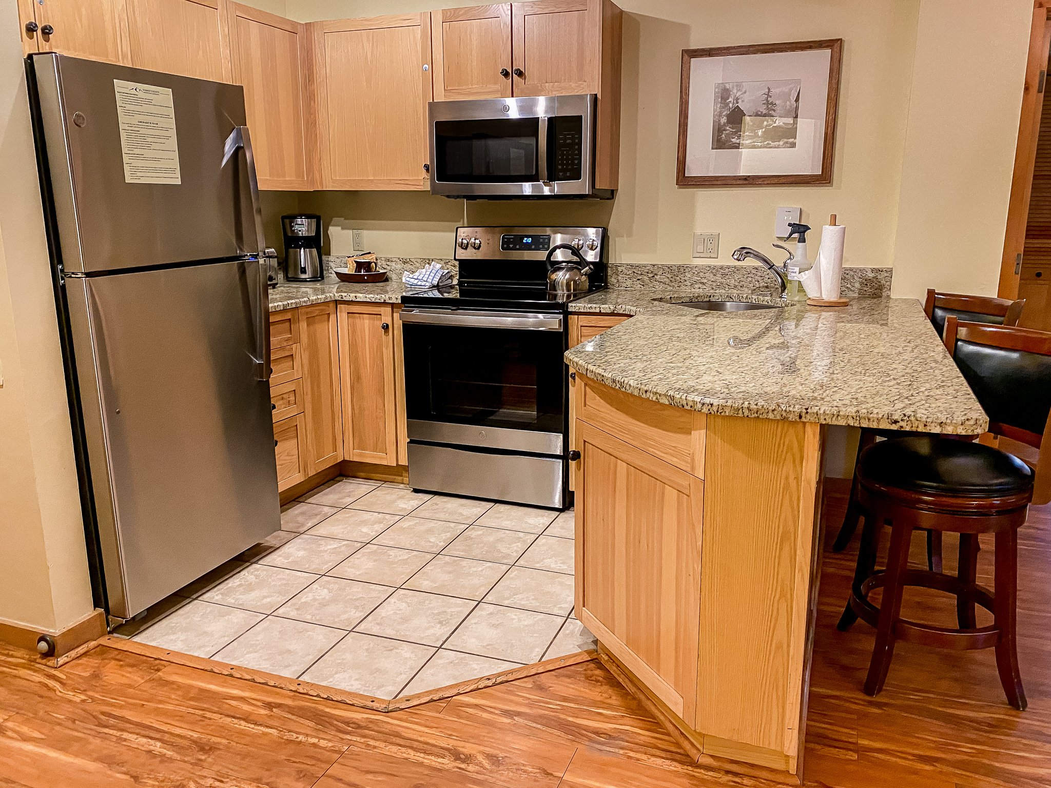The kitchen features new stainless steel appliances and granite countertops.