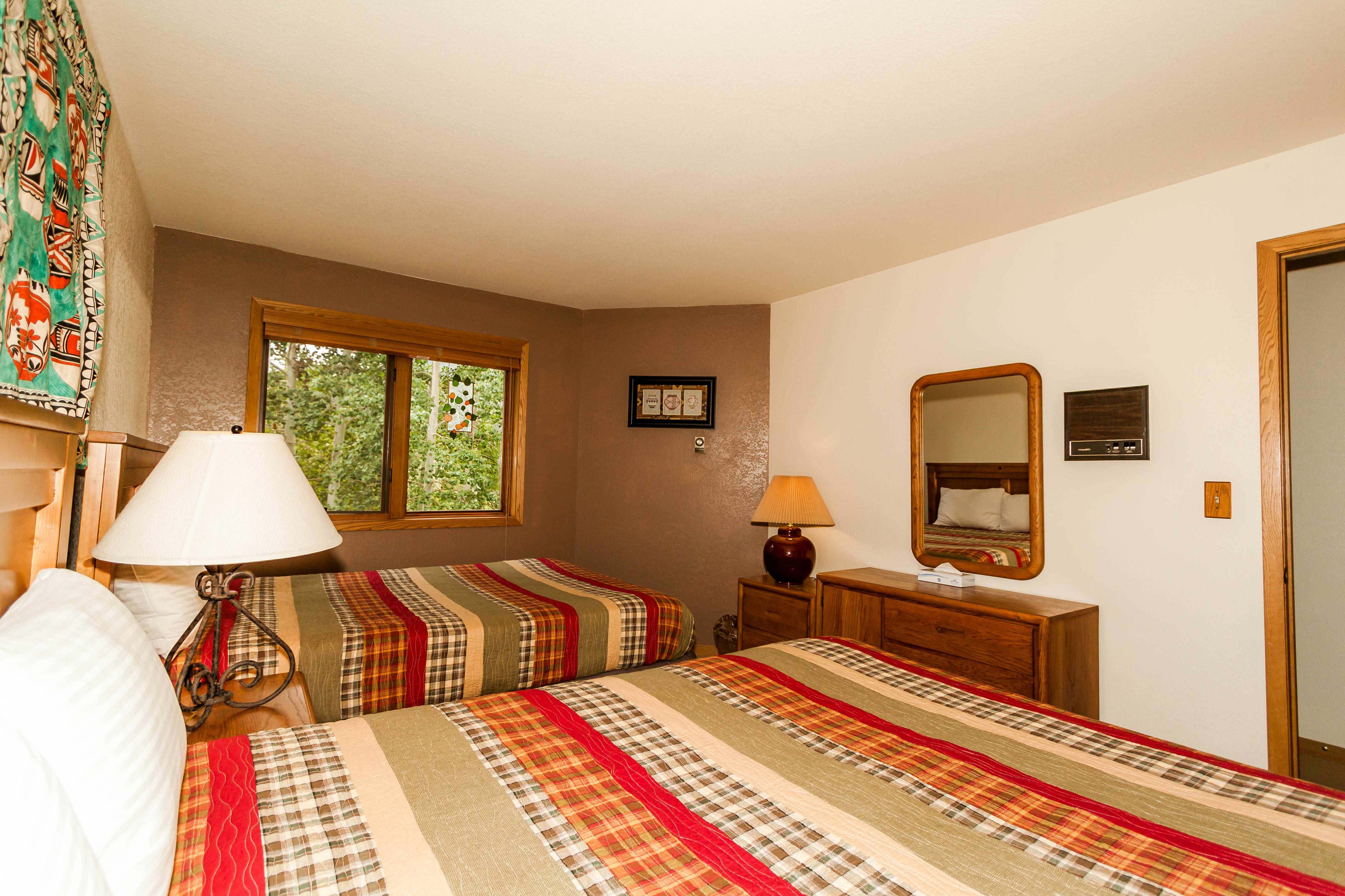The guest bedroom features two queen-sized beds.