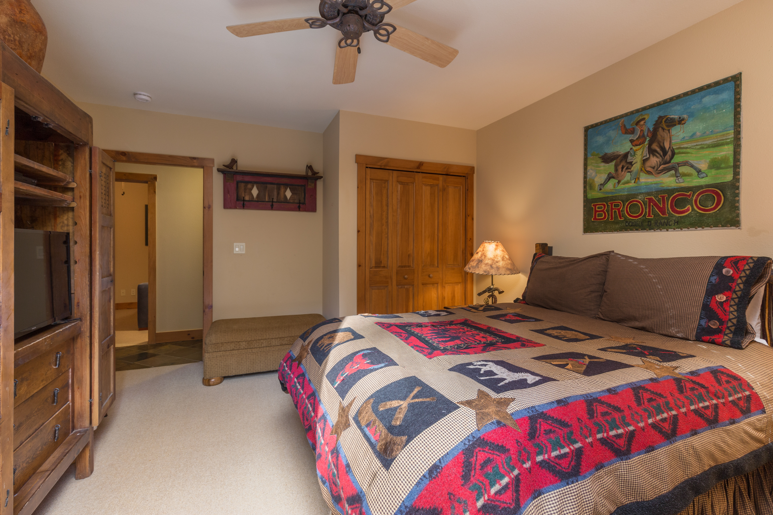 The second guest bedroom features a queen-sized bed, a flat screen TV and its own private balcony.