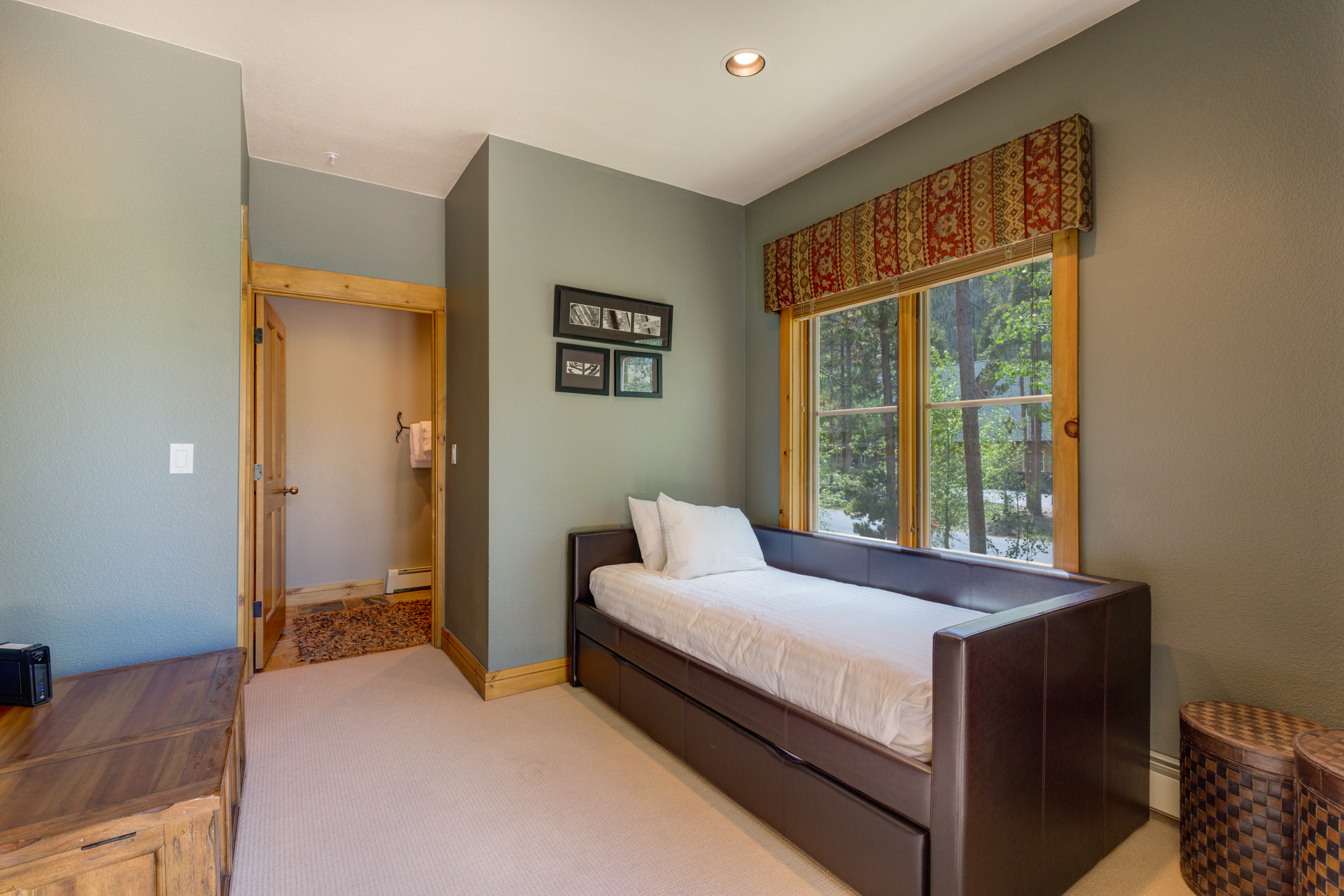 The third guest bedroom is on the main level and features a twin-sized bed with a twin trundle. It has its own access to the guest bathroom and access to the private patio.
