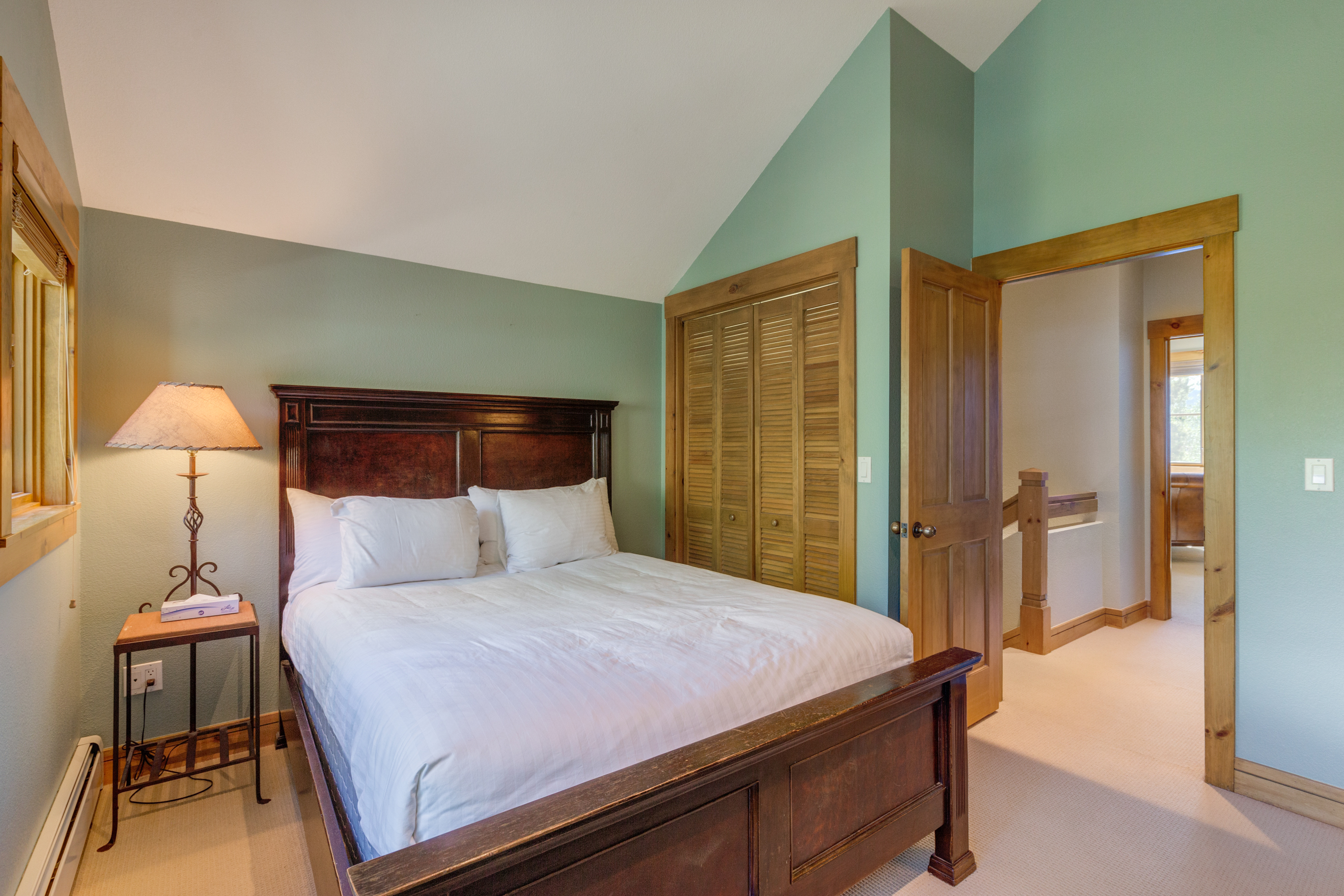 The first guest bedroom features a queen-sized bed and has access to a jack-and-jill bathroom.
