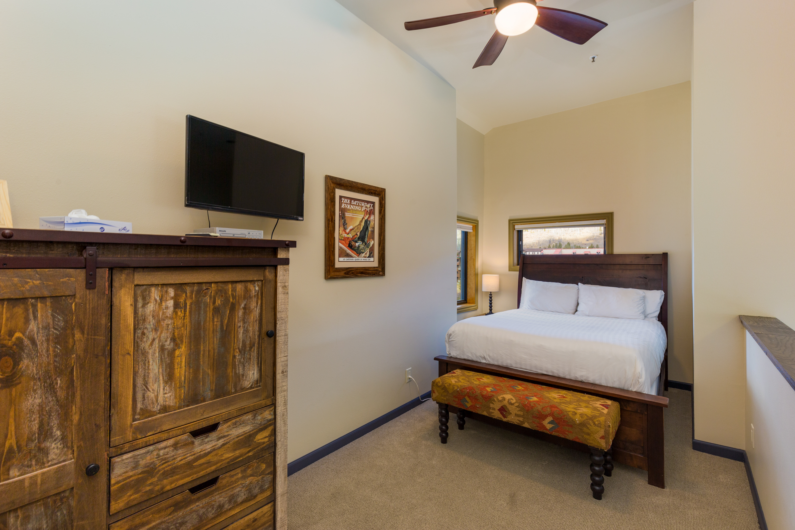 The guest bedroom is the upstairs loft and features a queen-sized bed with Ivory White Bedding, a flat screen TV and mountain views.