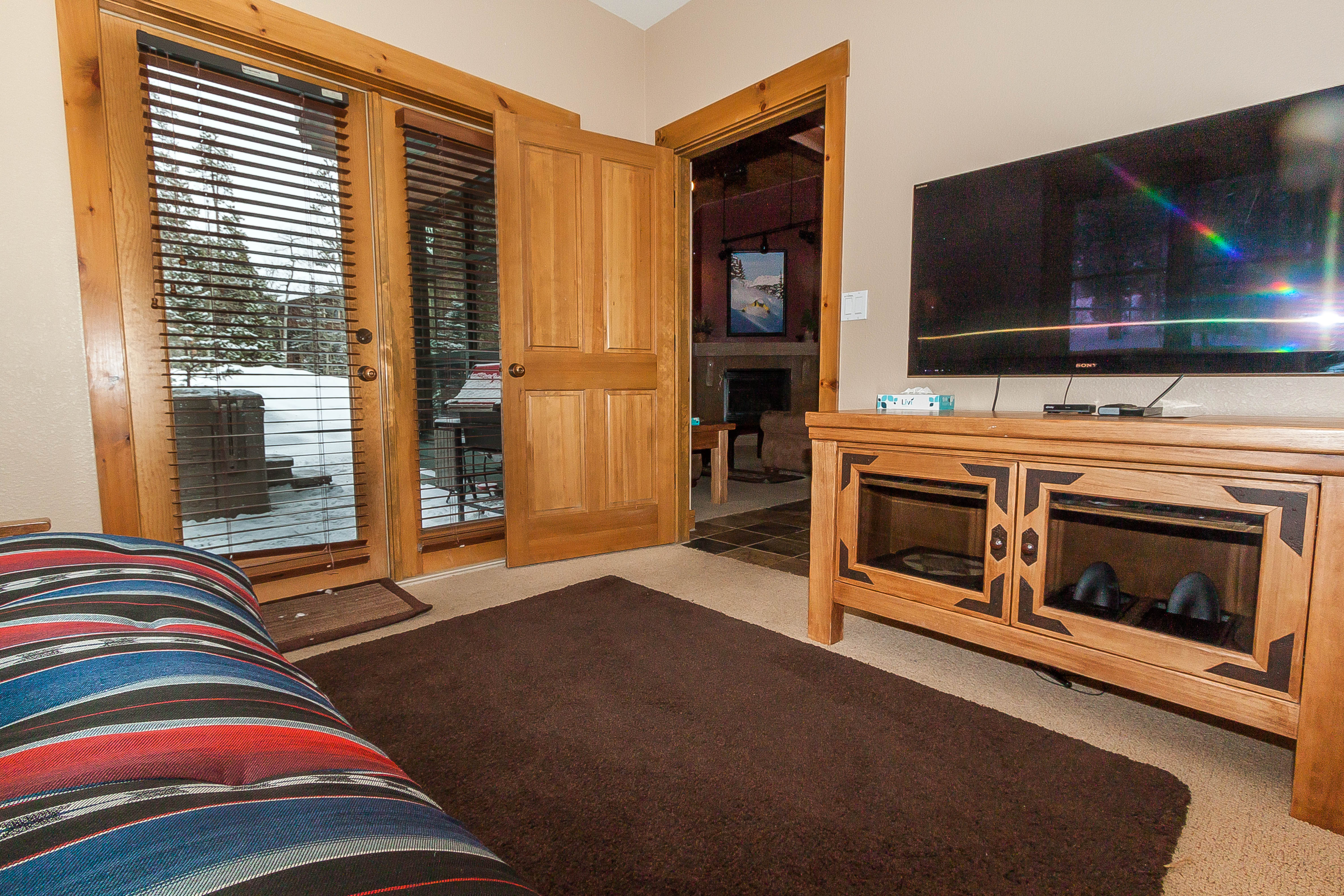 The third guest bedroom also serves as a den with a futon, a flat screen TV and its own access to the downstairs guest bathroom. Head out to the private patio with a hot tub.