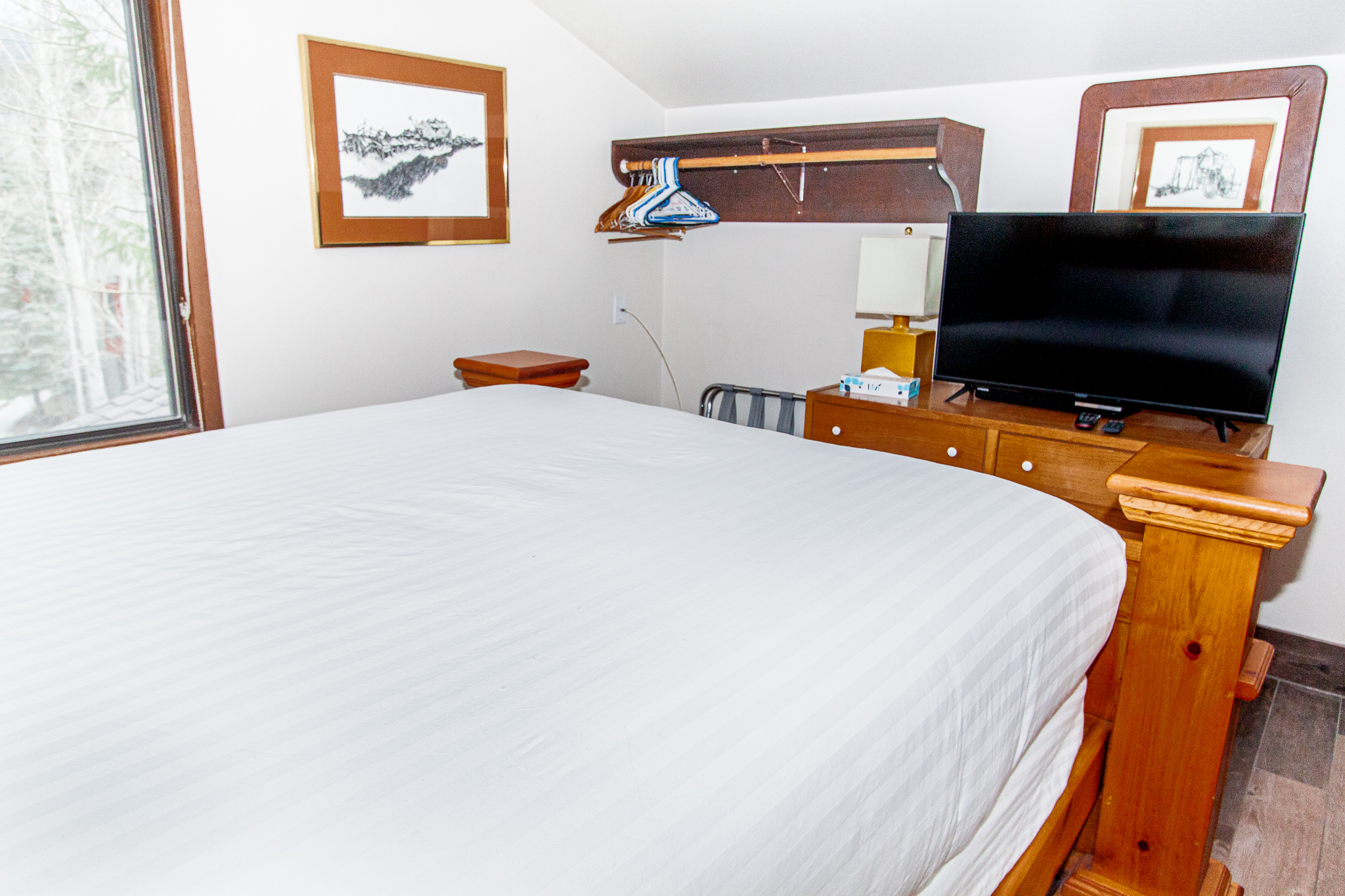 The master bedroom features a queen-sized bed and a flat screen TV. **New photo coming soon.**